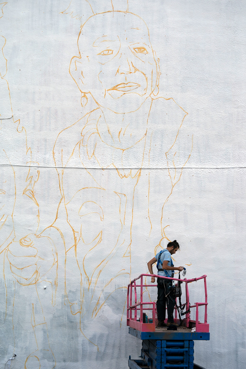 Giuseppe Percivati roughs the outline of the mural