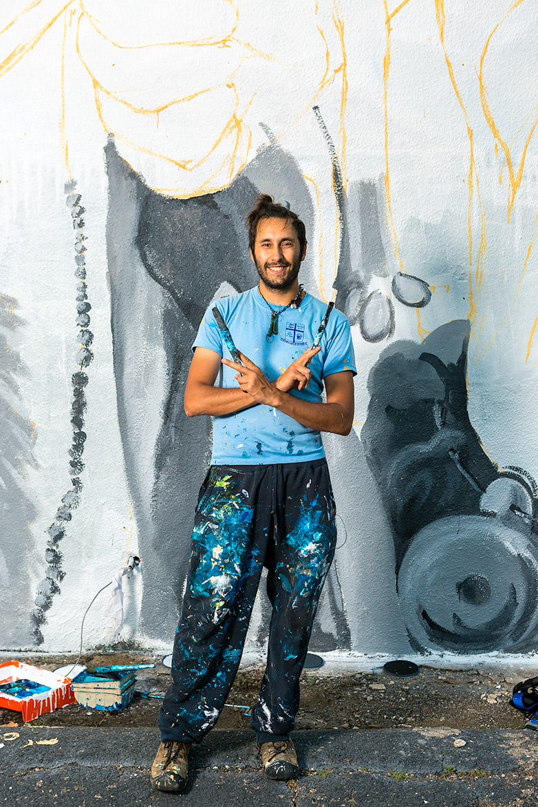 Giuseppe Percivati poses before his mural's underpainting