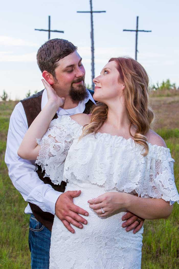 Groom and Bride kiss at Timberlodge Ranch