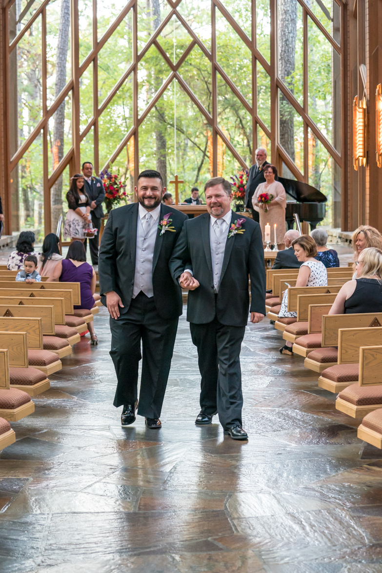 Gay couple walking the aisle at Anthony Chapel