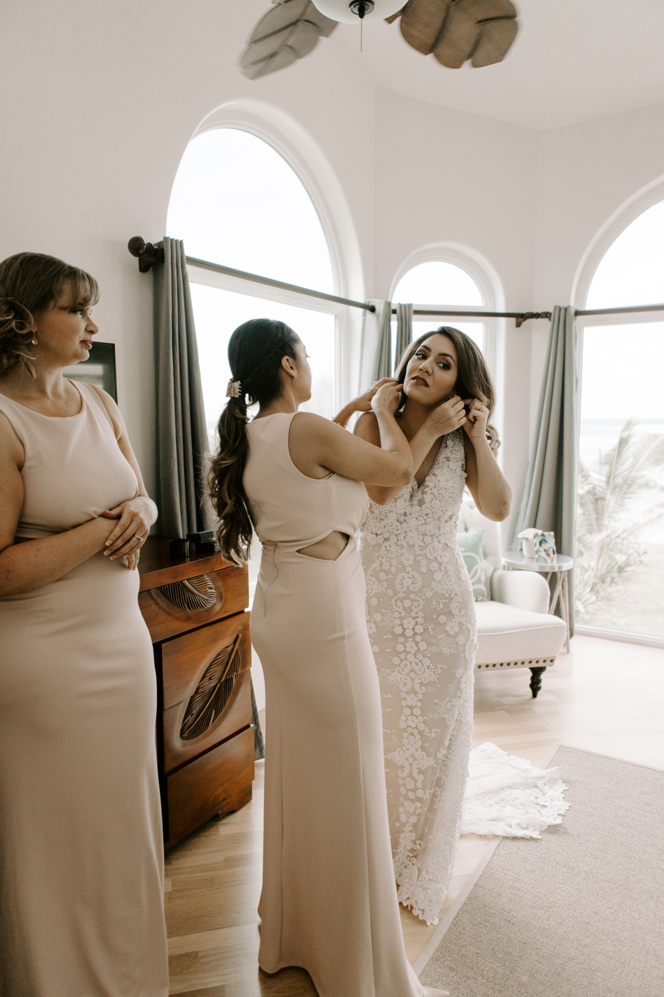 Bride and her bridesmaids getting ready