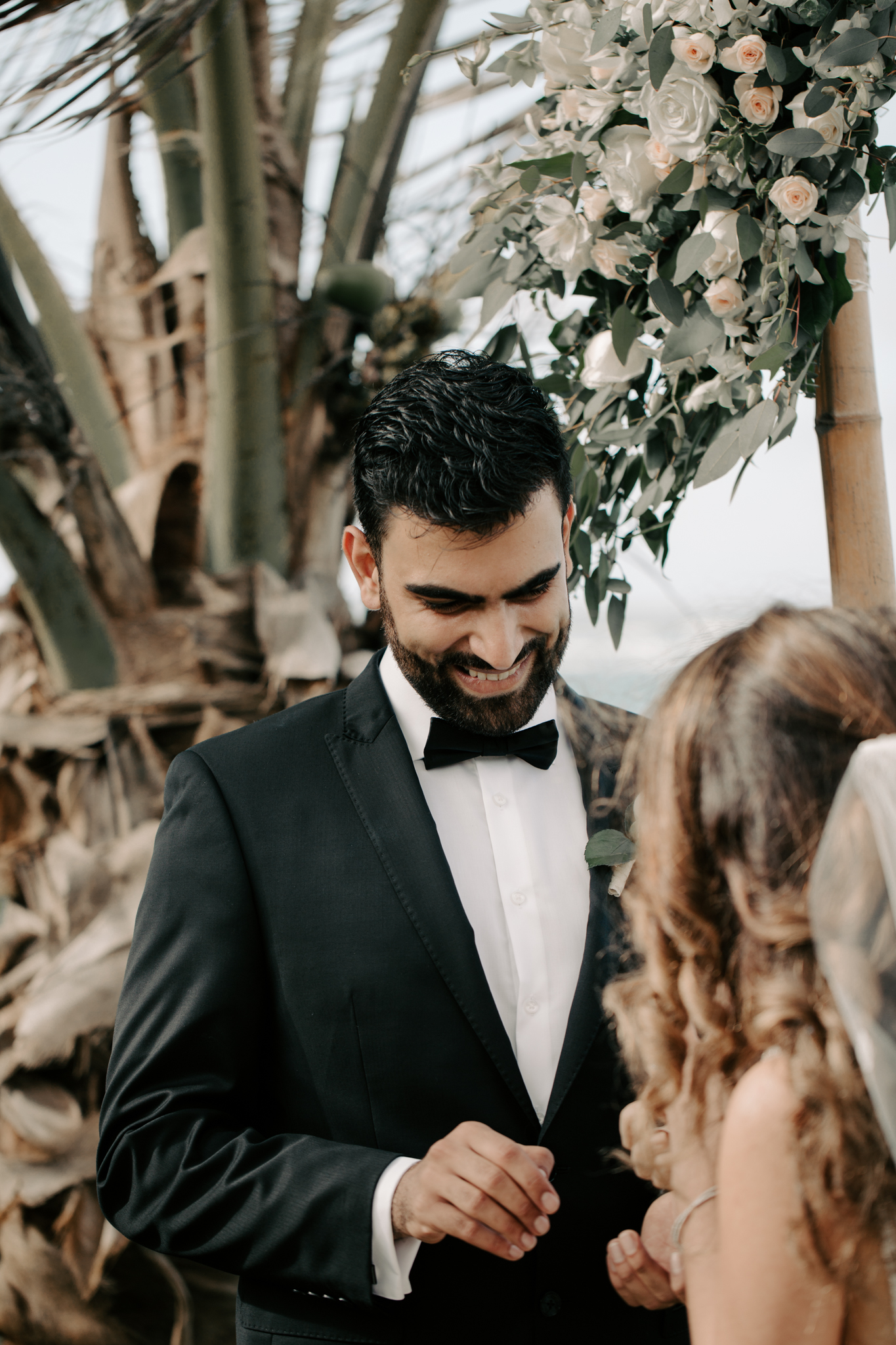 Groom putting ring on