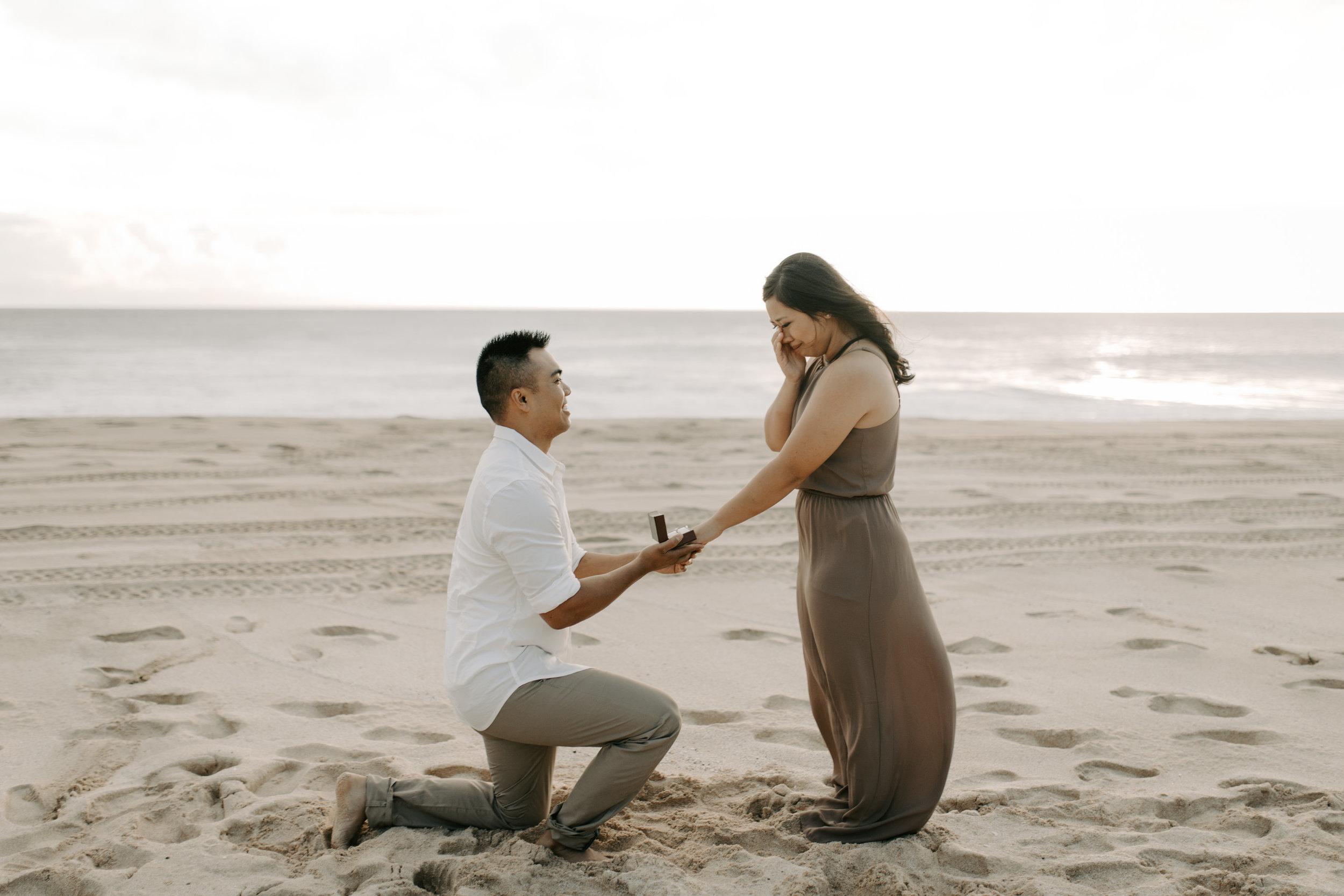 Surprise Proposal at Yokohama Bay by Oahu Wedding Photographer Desiree Leilani