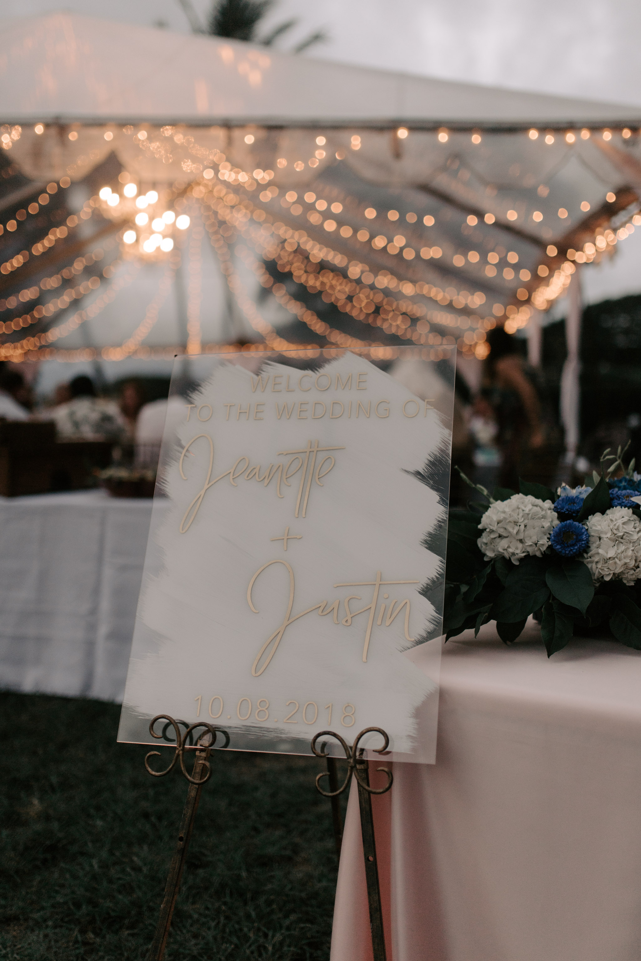 Beautiful gold custom wedding sign at Kualoa Ranch Paliku Gardens. Photography by Hawaii wedding photographer Desiree Leilani
