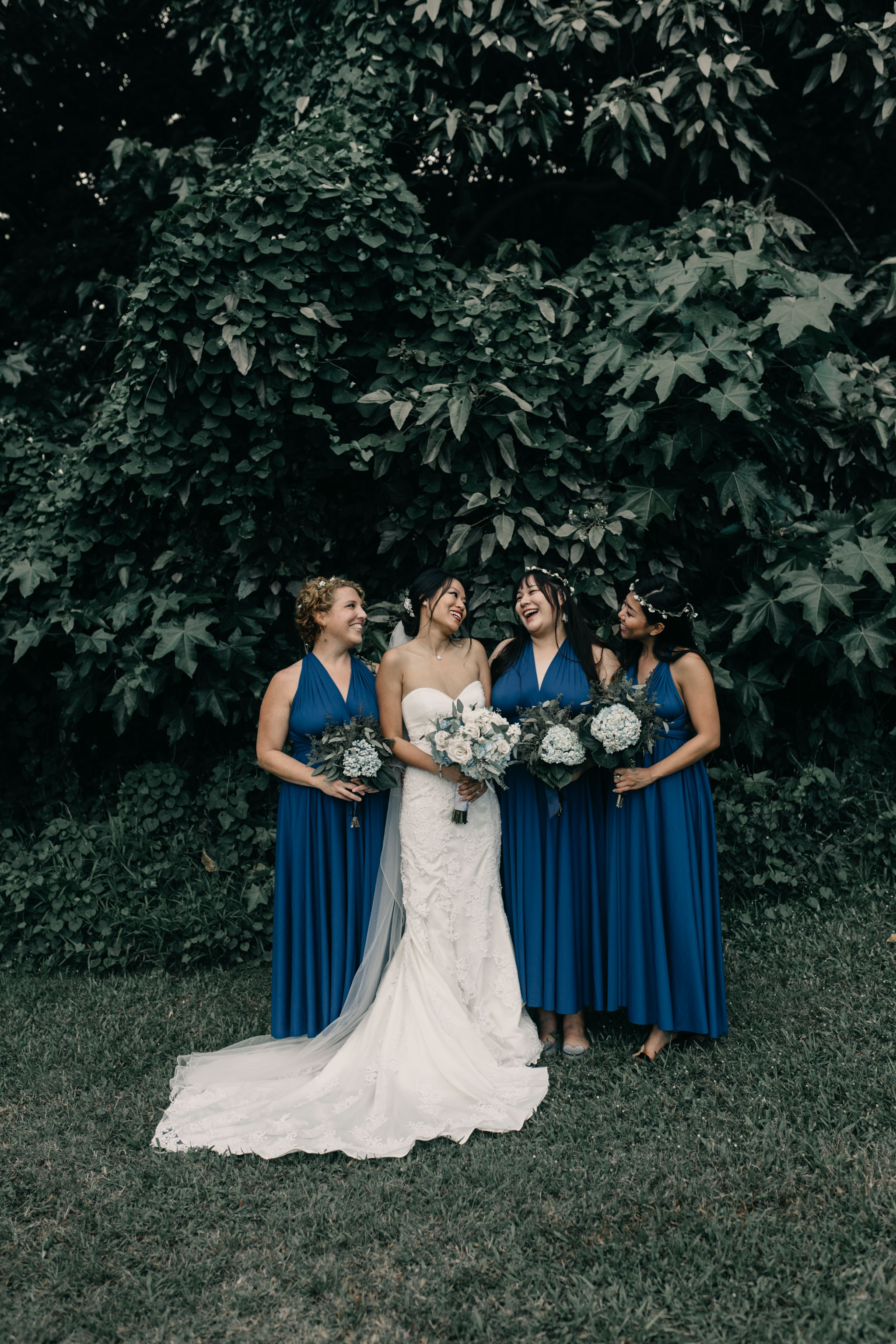 Bridesmaids laughing photo at Kualoa Ranch Paliku Gardens. Photography by Hawaii fine art wedding photographer Desiree Leilani
