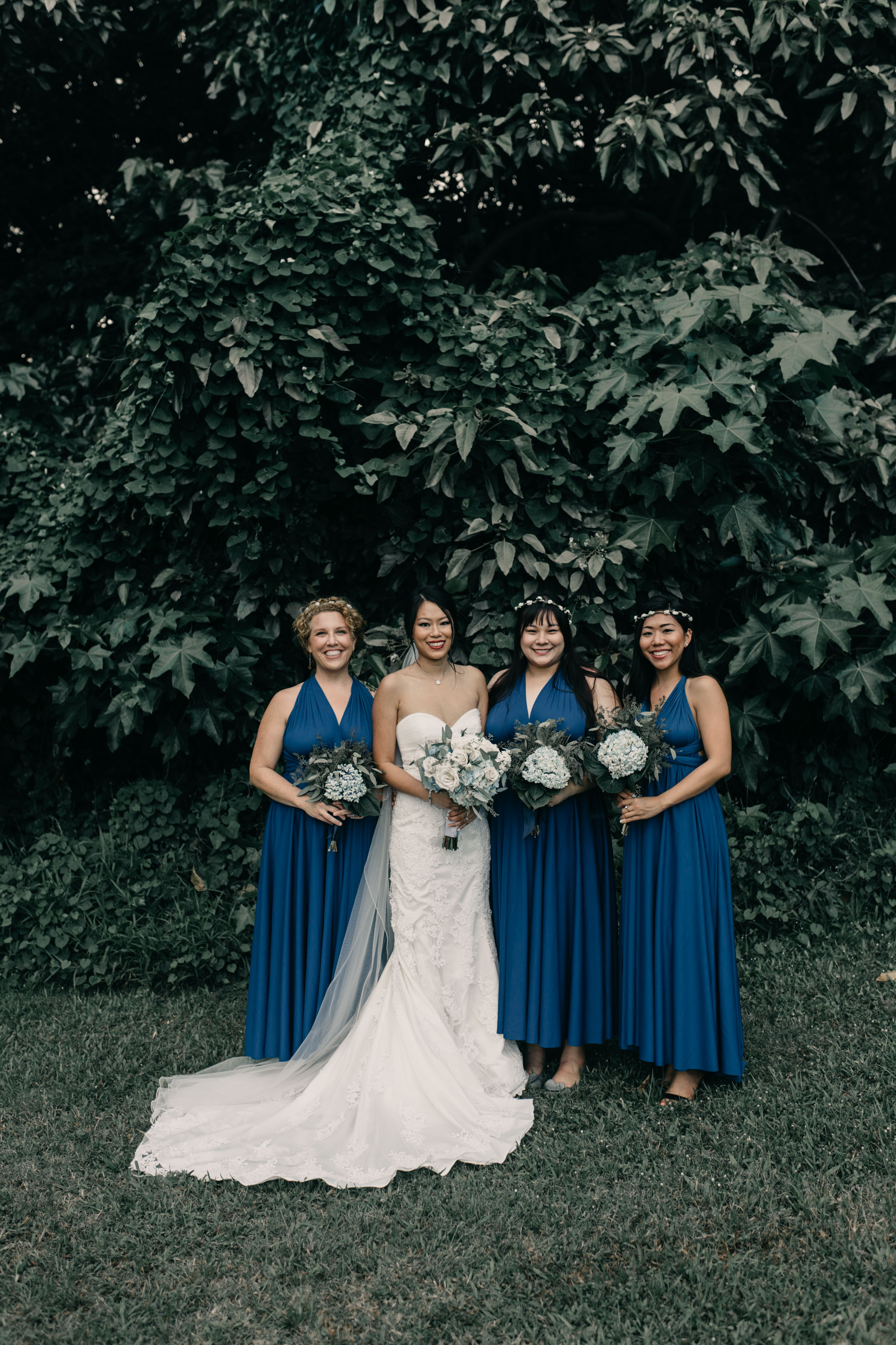 Blue bridesmaids dresses at Kualoa Ranch Paliku Gardens. Photography by Hawaii fine art wedding photographer Desiree Leilani