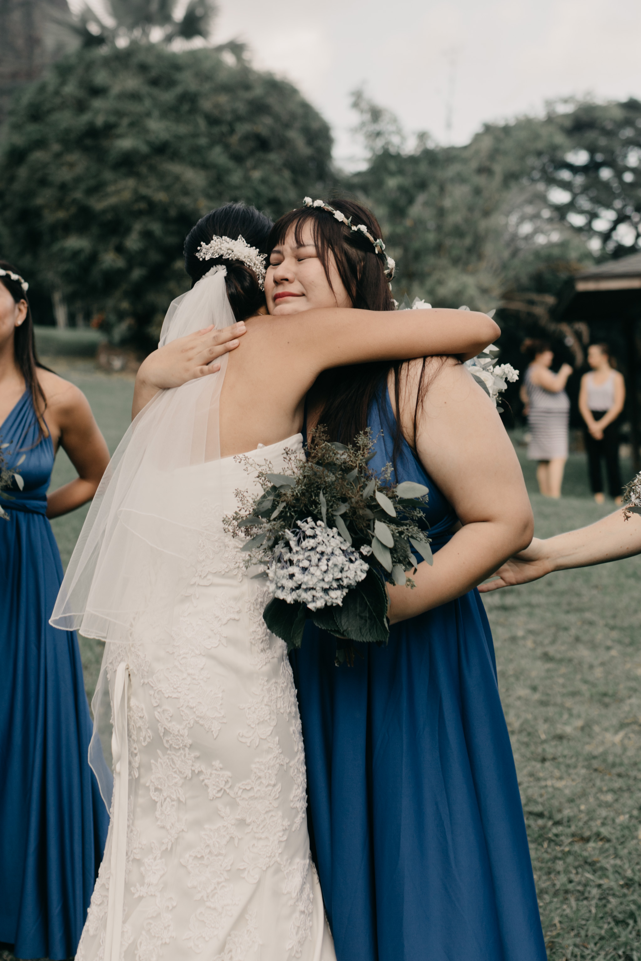 Emotional congratulations at Kualoa Ranch Paliku Gardens. Photography by Hawaii wedding photographer Desiree Leilani