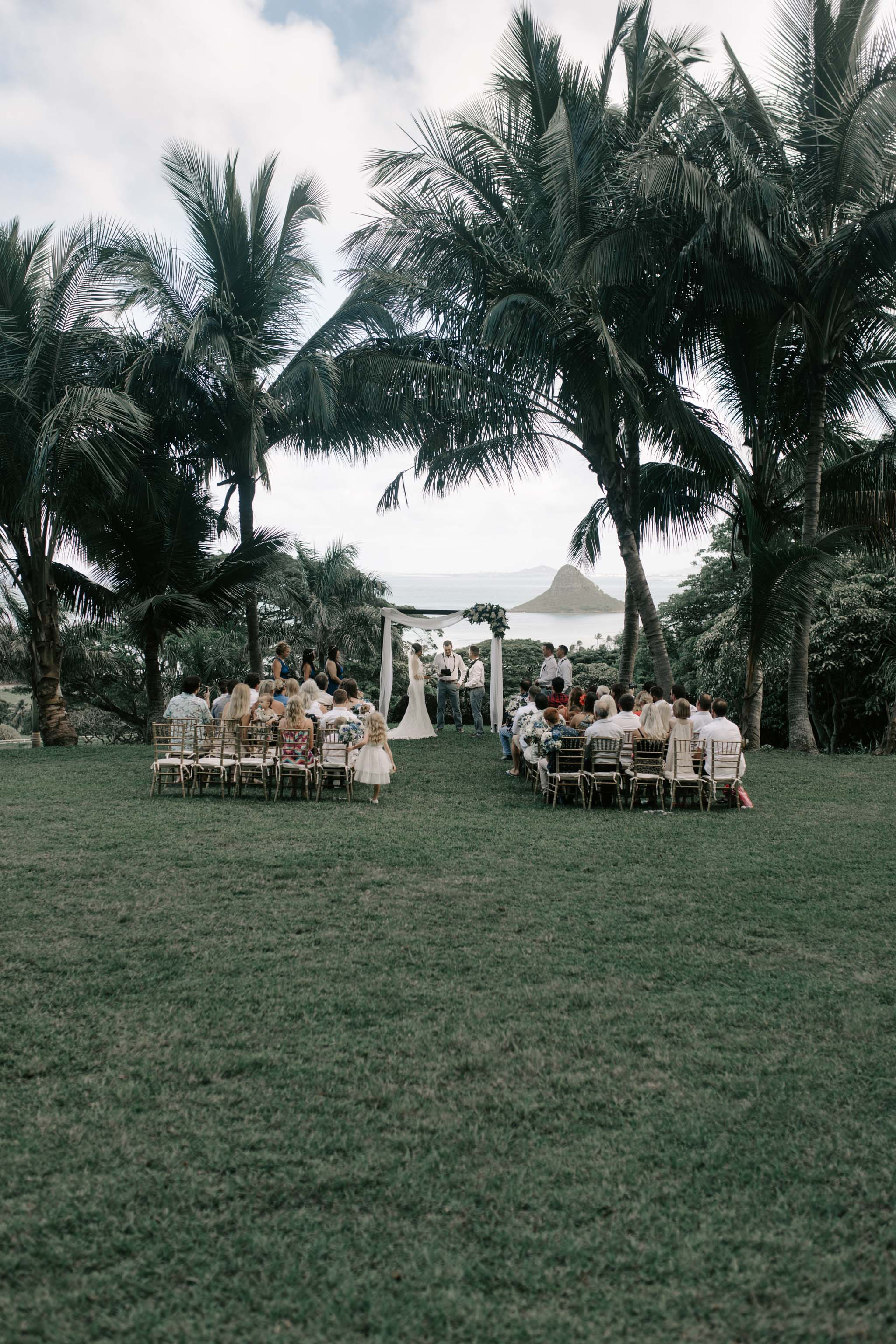 Kualoa Ranch Paliku Gardens Wedding Ceremony. Photography by Hawaii wedding photographer Desiree Leilani