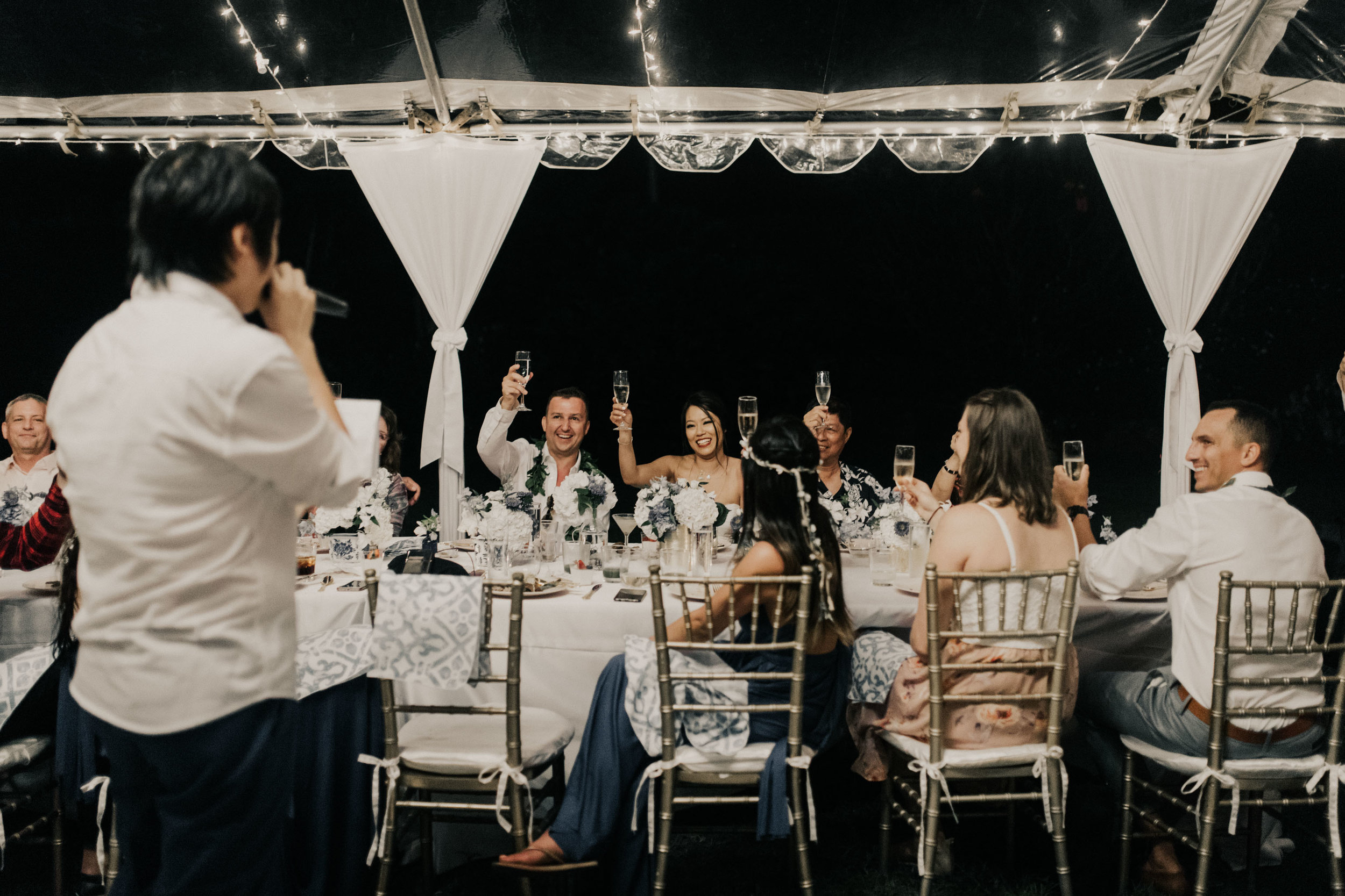 Toasting the bride and groom at a Kualoa Ranch wedding. Photo by Oahu wedding photographer Desiree Leilani