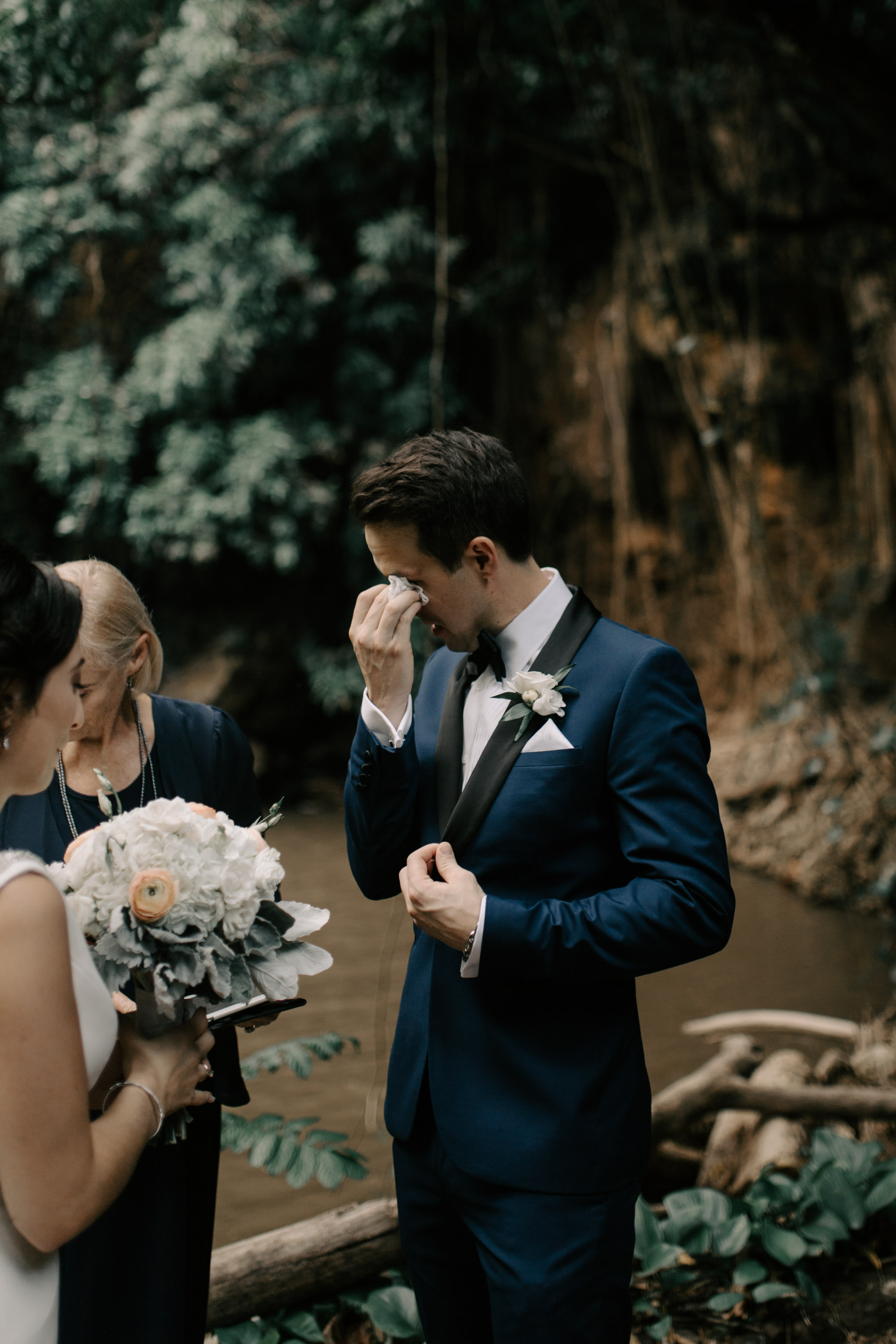 Groom tearing up at ceremony-Waihulili Waterfall Wedding By Kauai Wedding Photographer Desiree Leilani