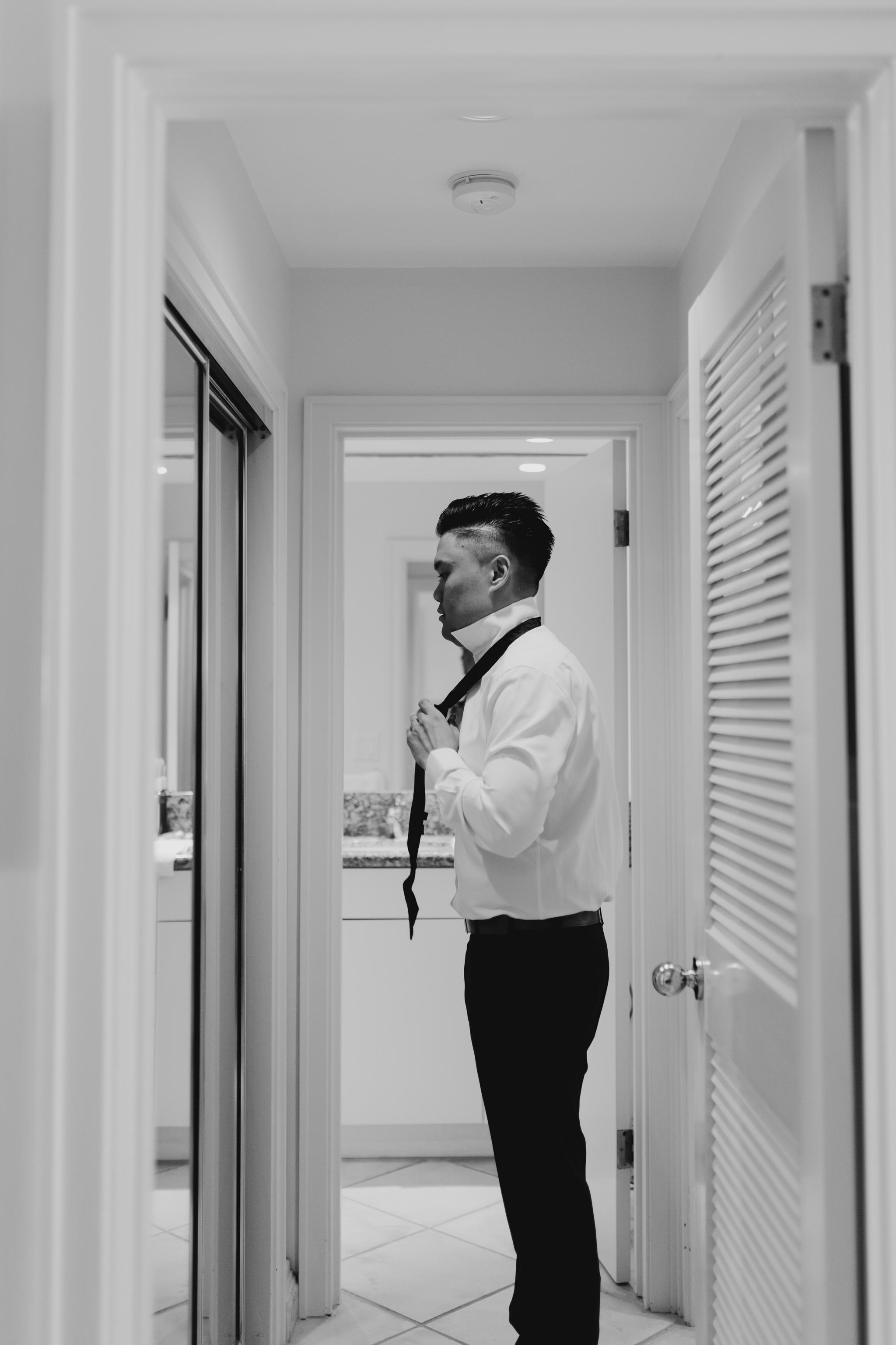 Groom getting ready photo by Maui Wedding Photographer Desiree Leilani