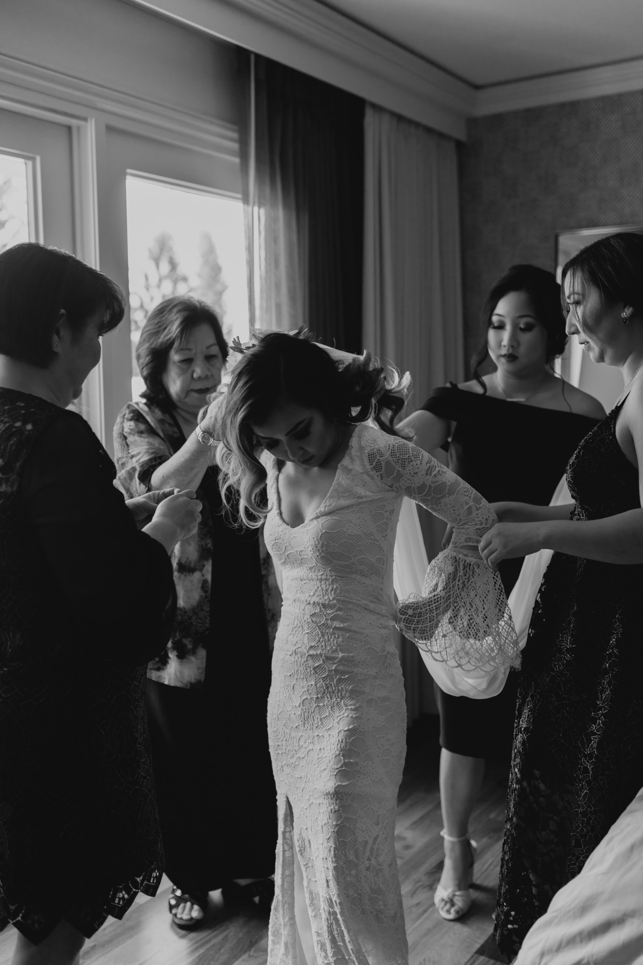 Bride getting into her Grace Loves Lace Piper wedding gown by Hawaii wedding photographer Desiree Leilani