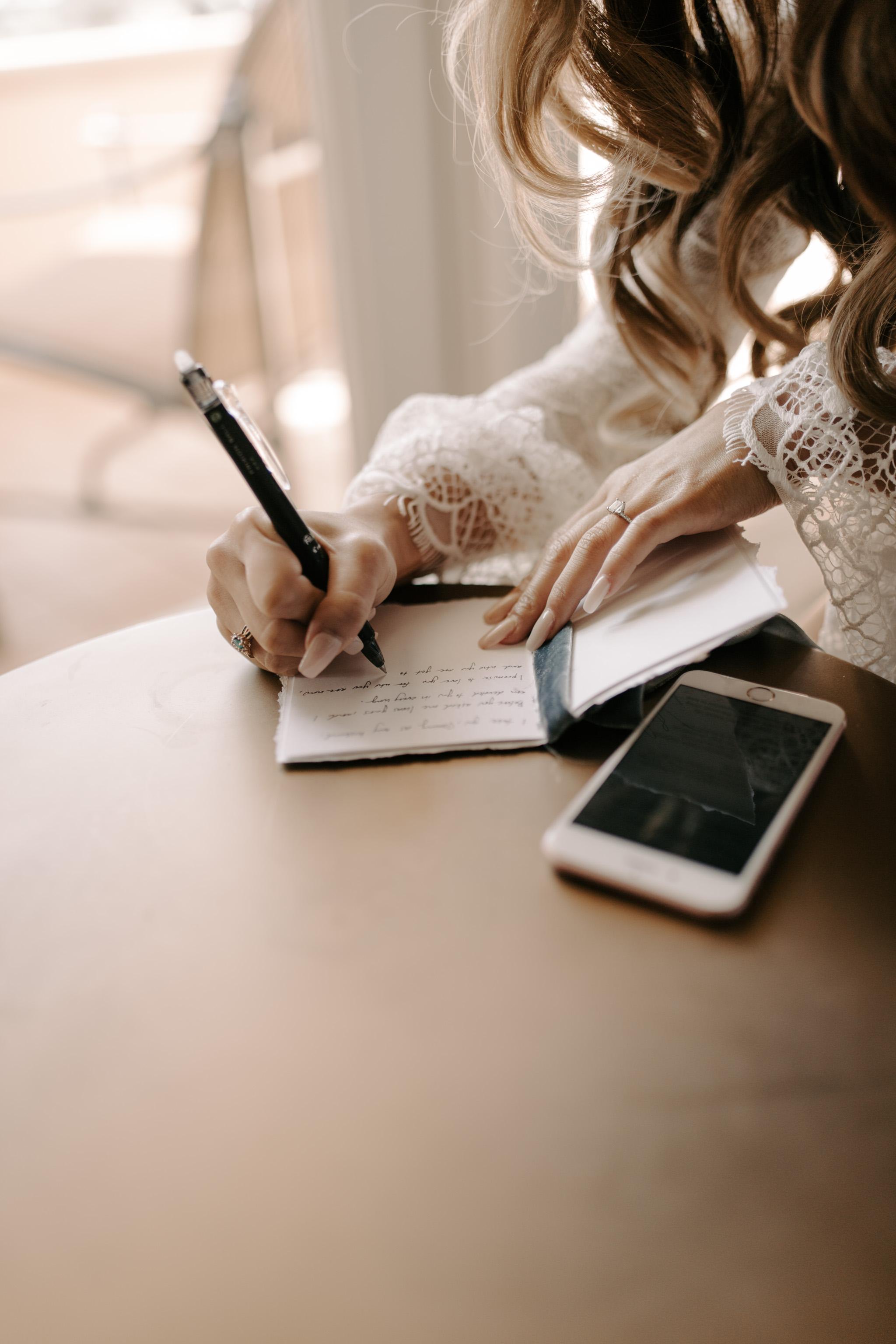 Bride writing her vows at the Ritz Carlton Maui by Hawaii wedding photographer Desiree Leilani