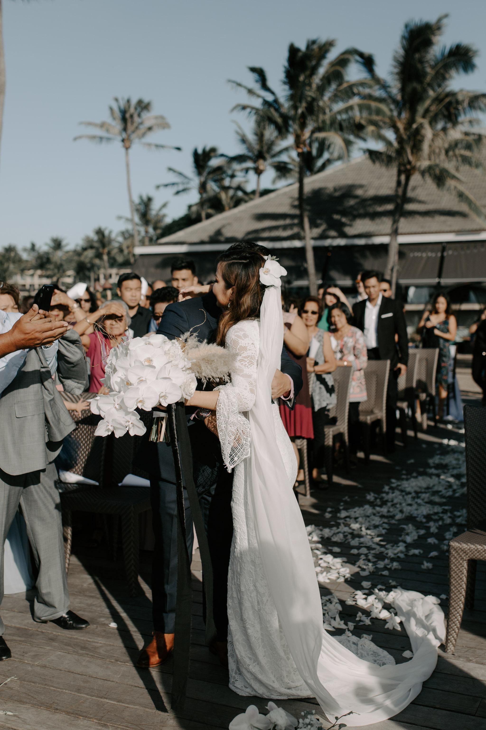 Father of the bride giving her away   Merriman's Kapalua Maui wedding by Hawaii wedding photographer Desiree Leilani