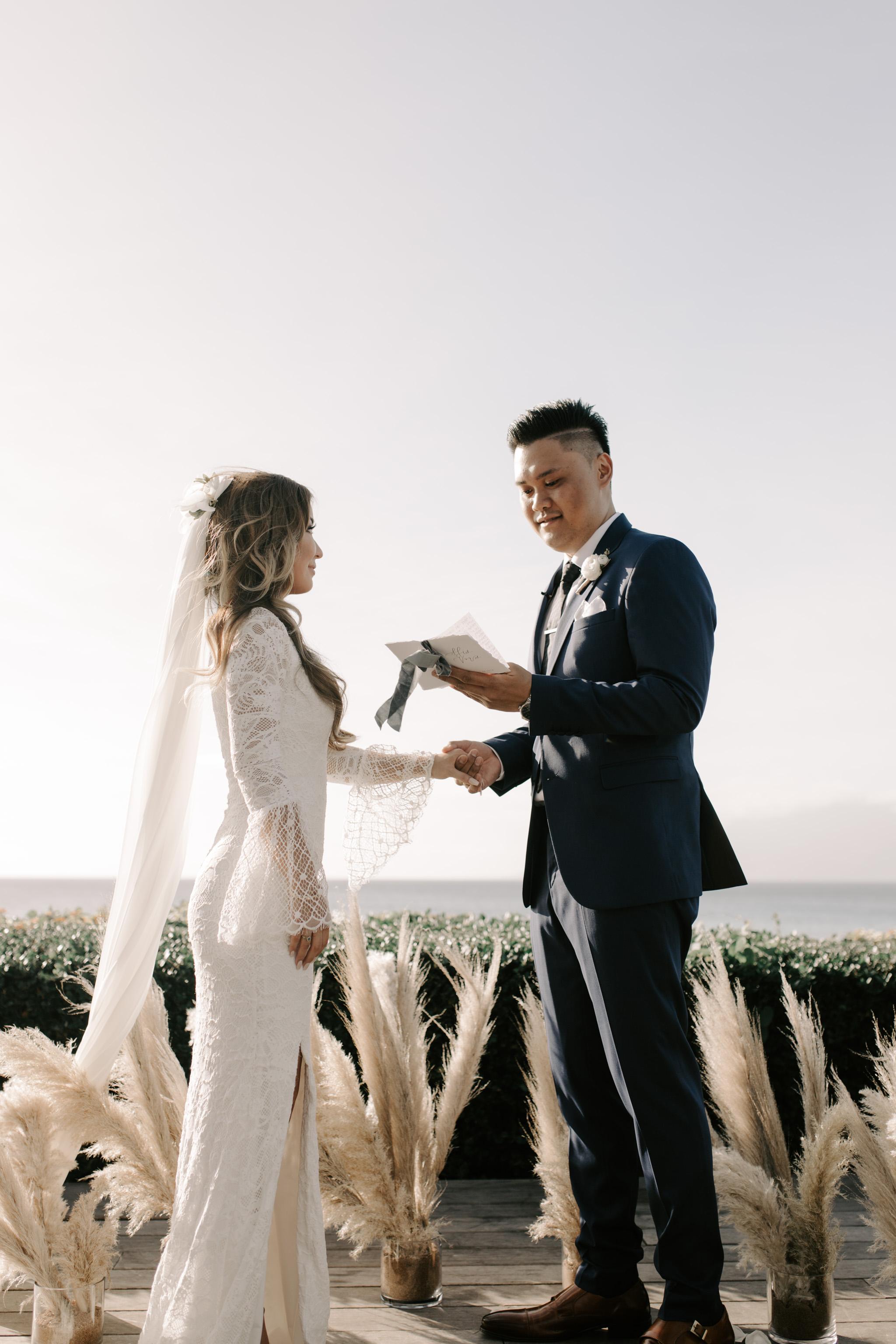 Groom reading his vows   Merriman's Kapalua Maui wedding by Hawaii wedding photographer Desiree Leilani