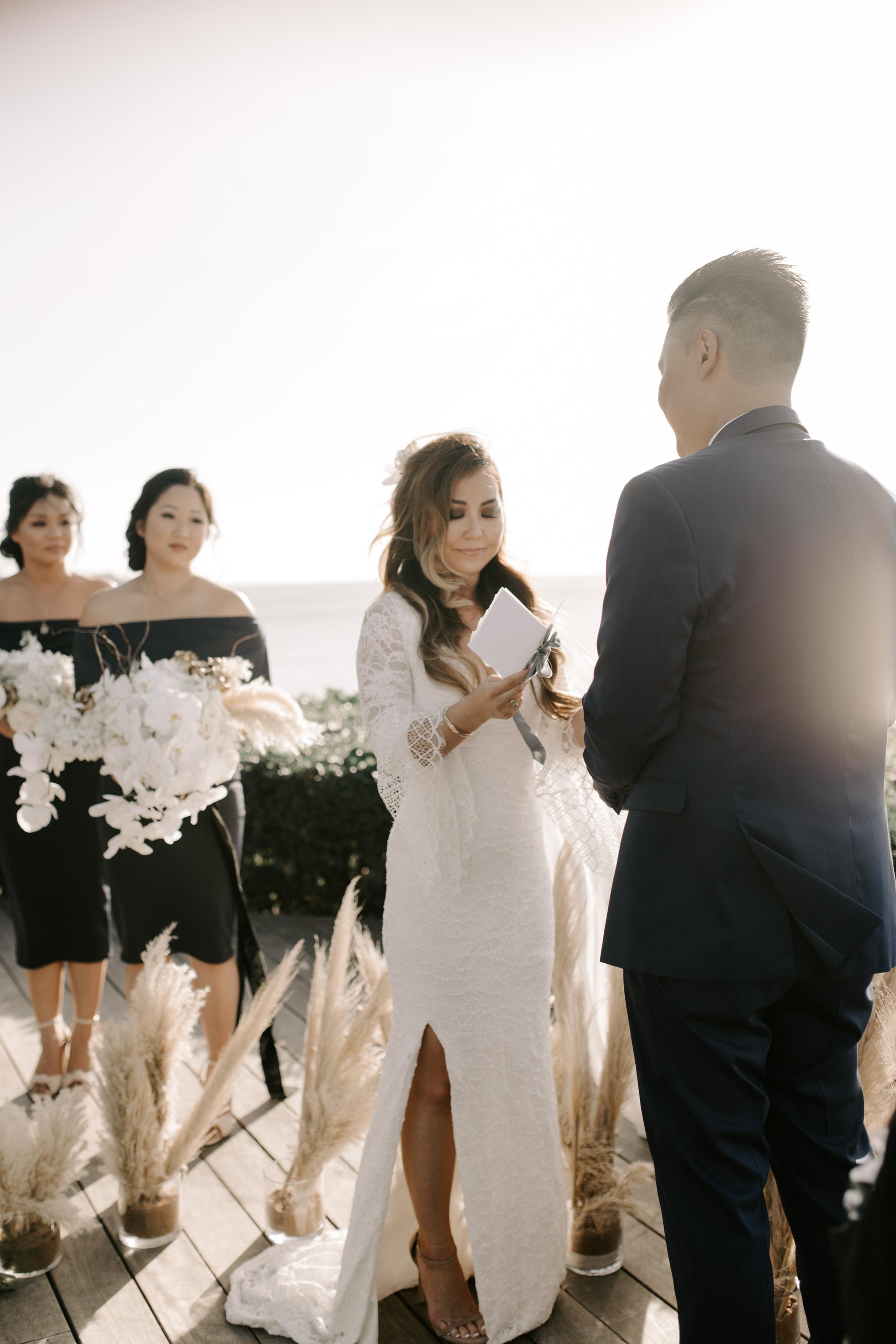 Bride reading her vows   Merriman's Kapalua Maui wedding by Hawaii wedding photographer Desiree Leilani