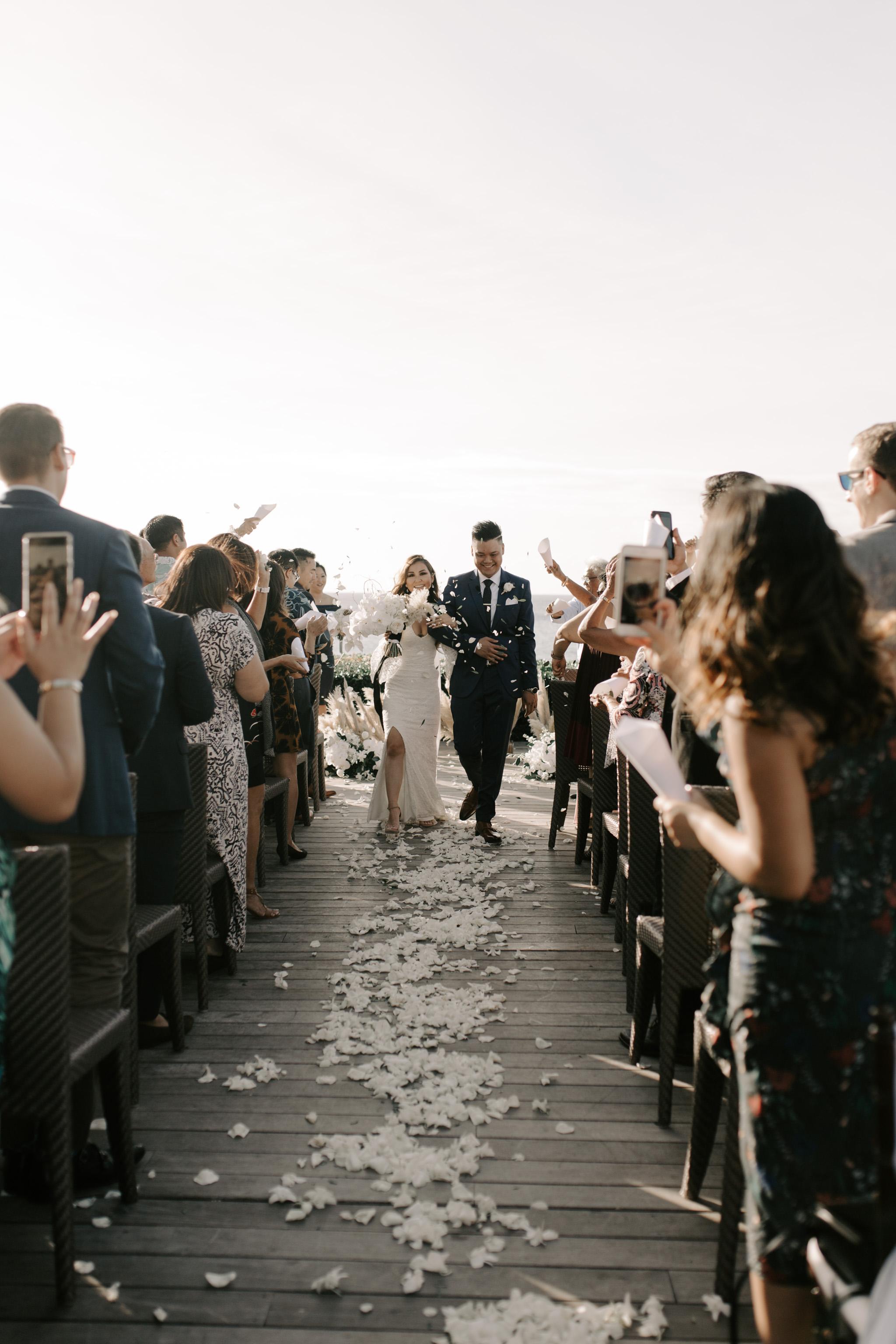 Flower petal exit   Merriman's Kapalua Maui wedding by Hawaii wedding photographer Desiree Leilani