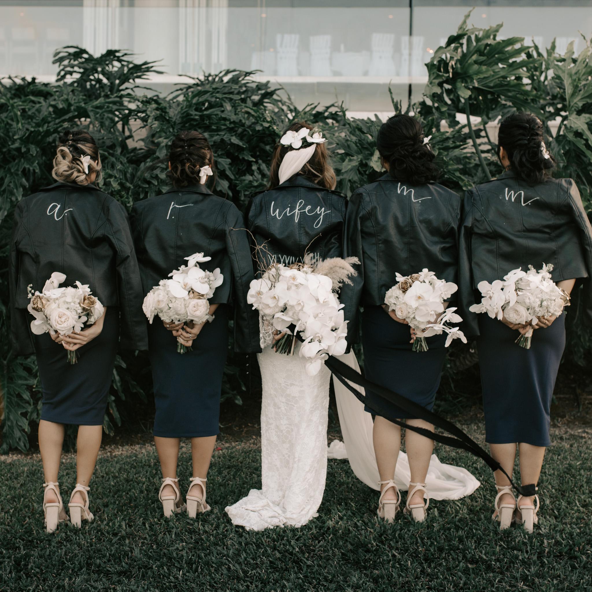Bride and bridesmaids leather jackets   Merriman's Kapalua Maui wedding by Hawaii wedding photographer Desiree Leilani