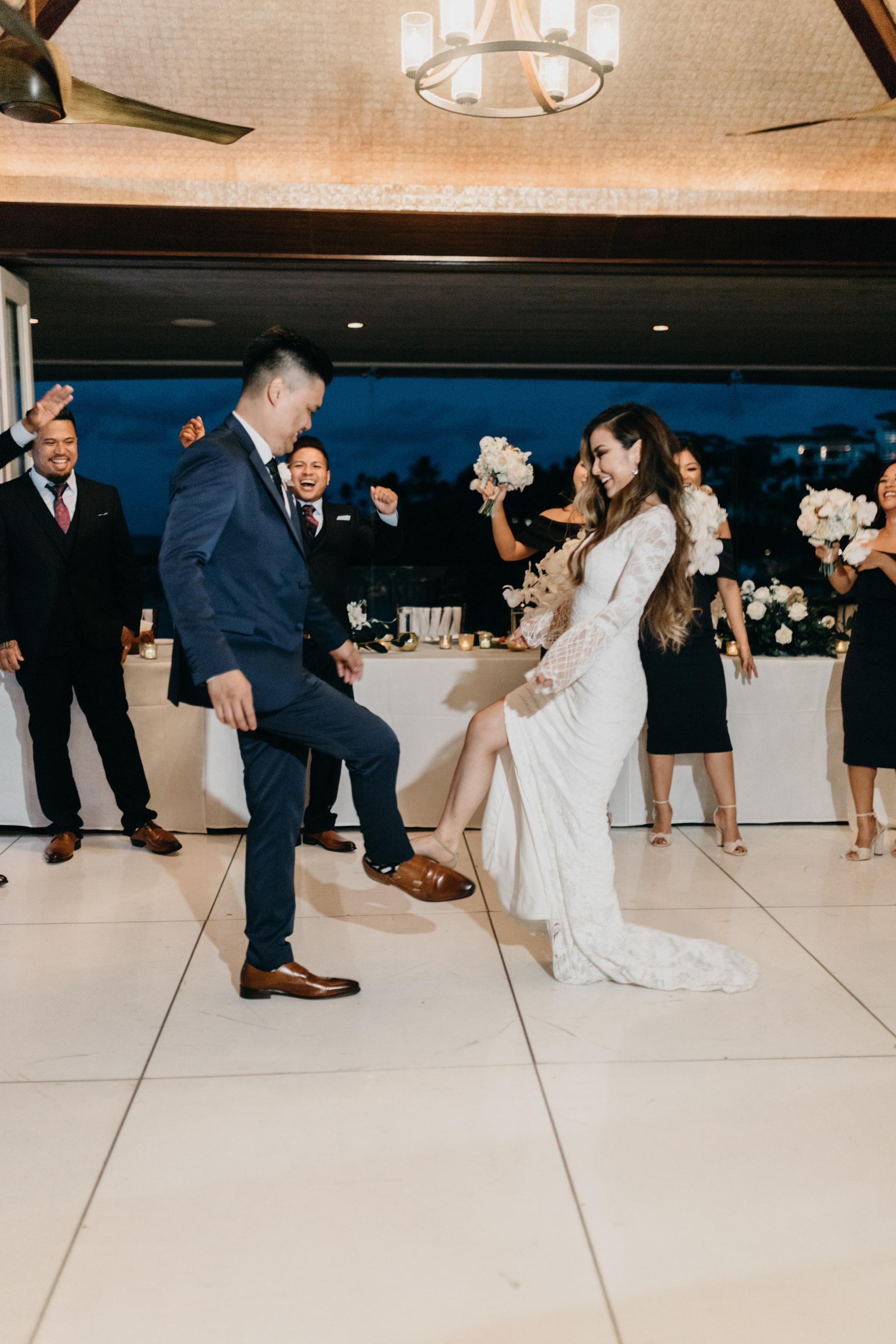 Bride and groom grand entrance   Merriman's Kapalua Maui wedding by Hawaii wedding photographer Desiree Leilani