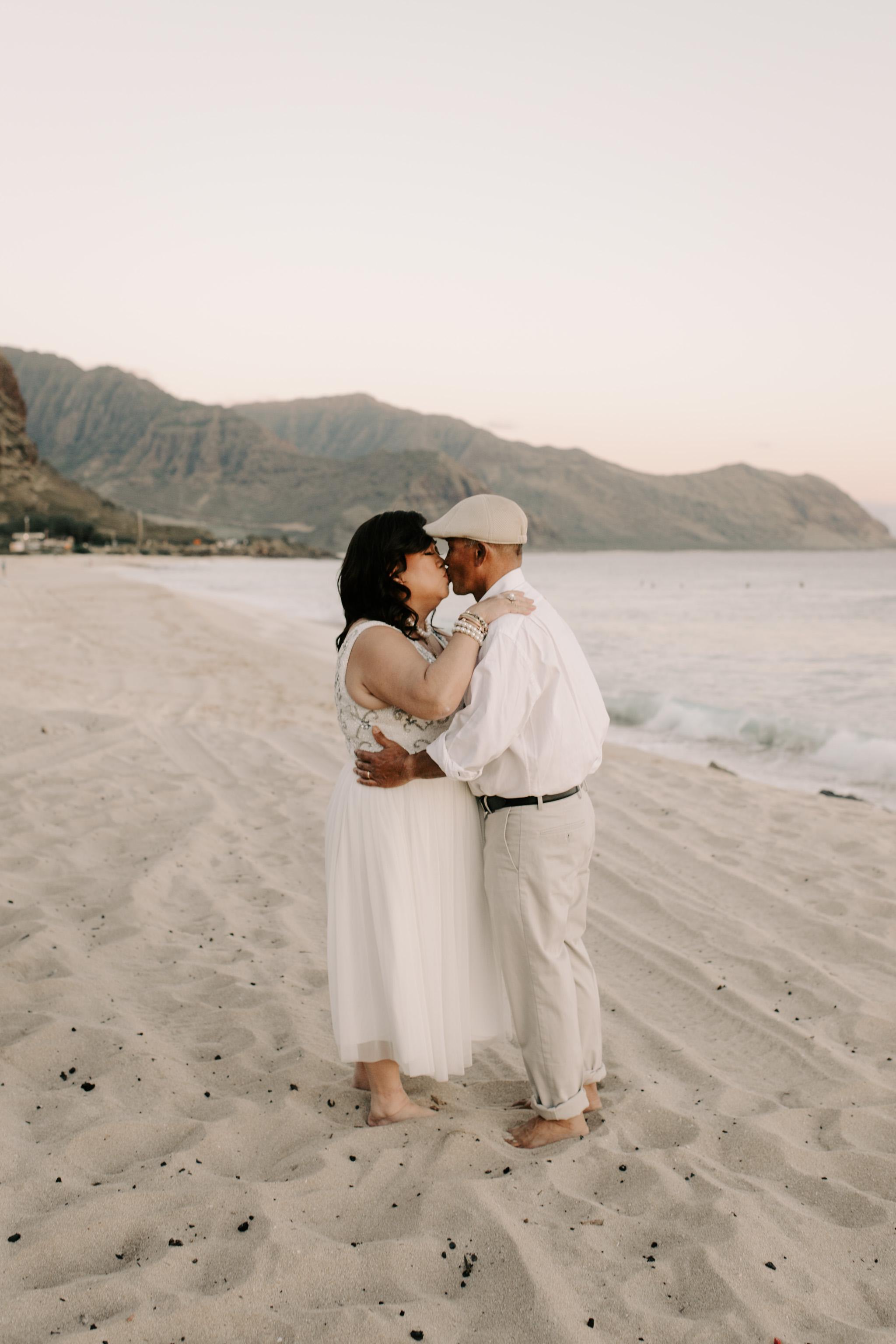 Mama Starrr and Papa Starrr renewing their vows at Yokohama Bay - Patrick Starrr Hawaii Family Photos by Hawaii family photographer Desiree Leilani