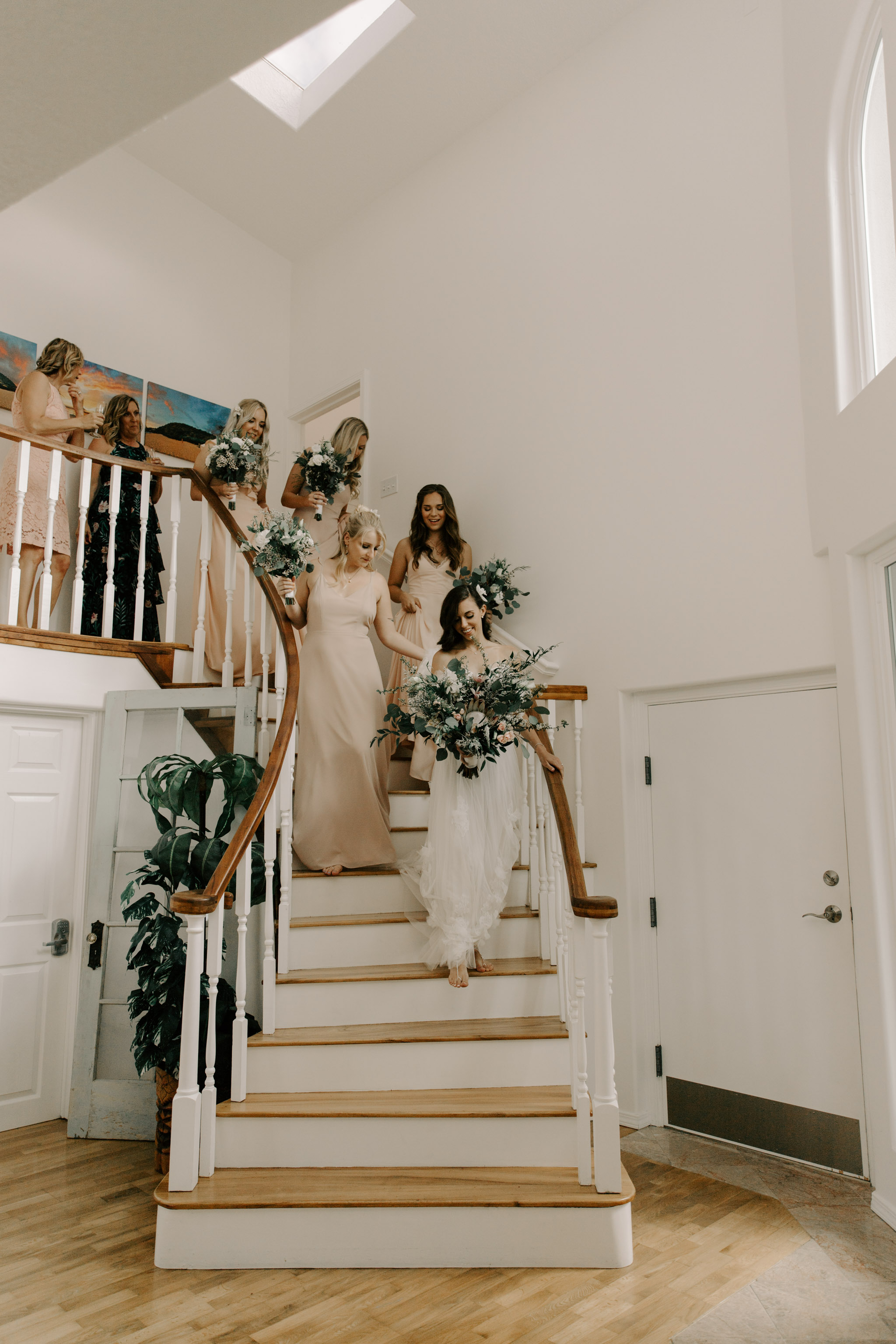 Bride and bridesmaids on their way to the ceremony- Laie Point Backyard Wedding By Hawaii Wedding Photographer Desiree Leilani