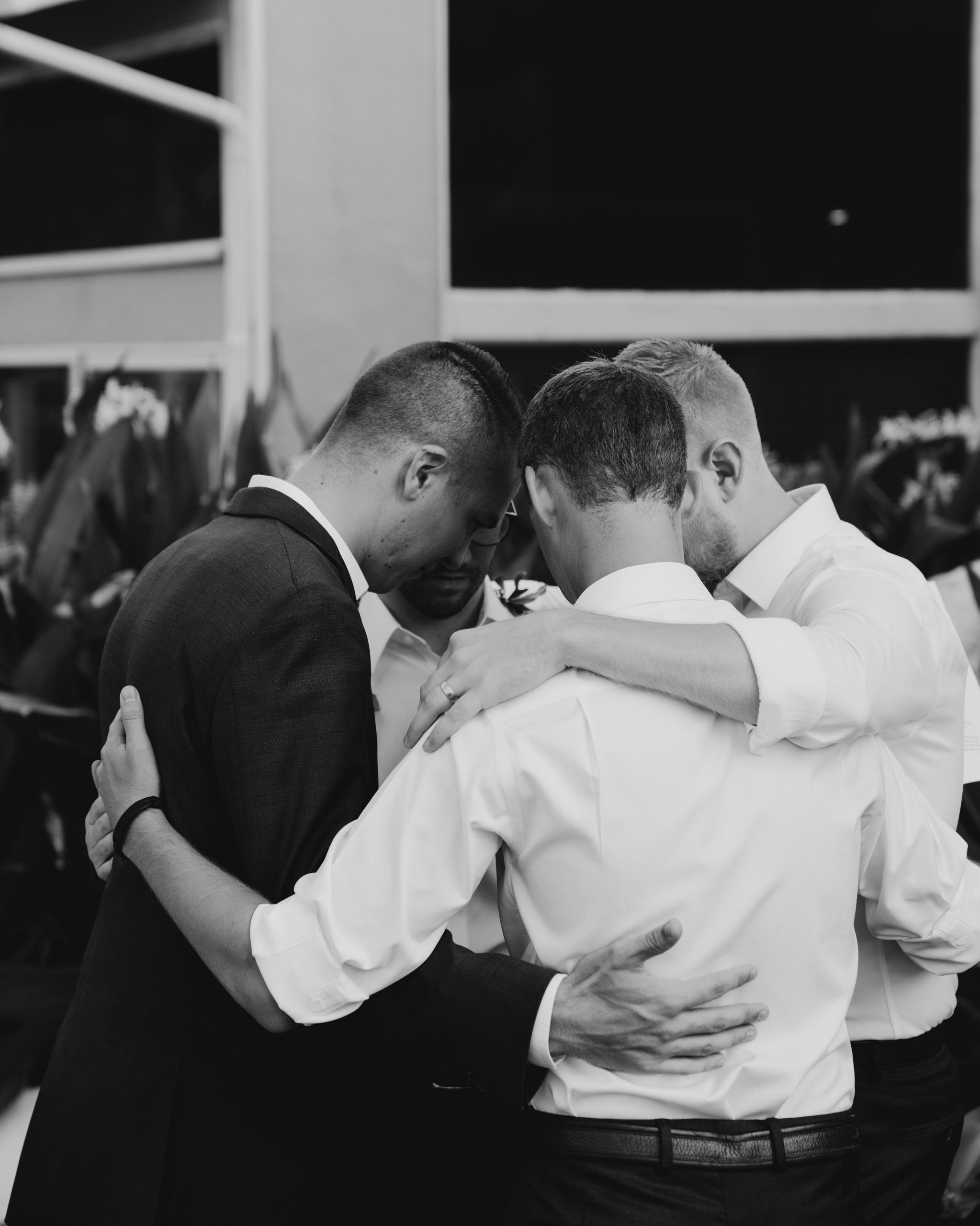 Groomsmen Praying Before The Ceremony- Laie Point Backyard Wedding By Hawaii Wedding Photographer Desiree Leilani