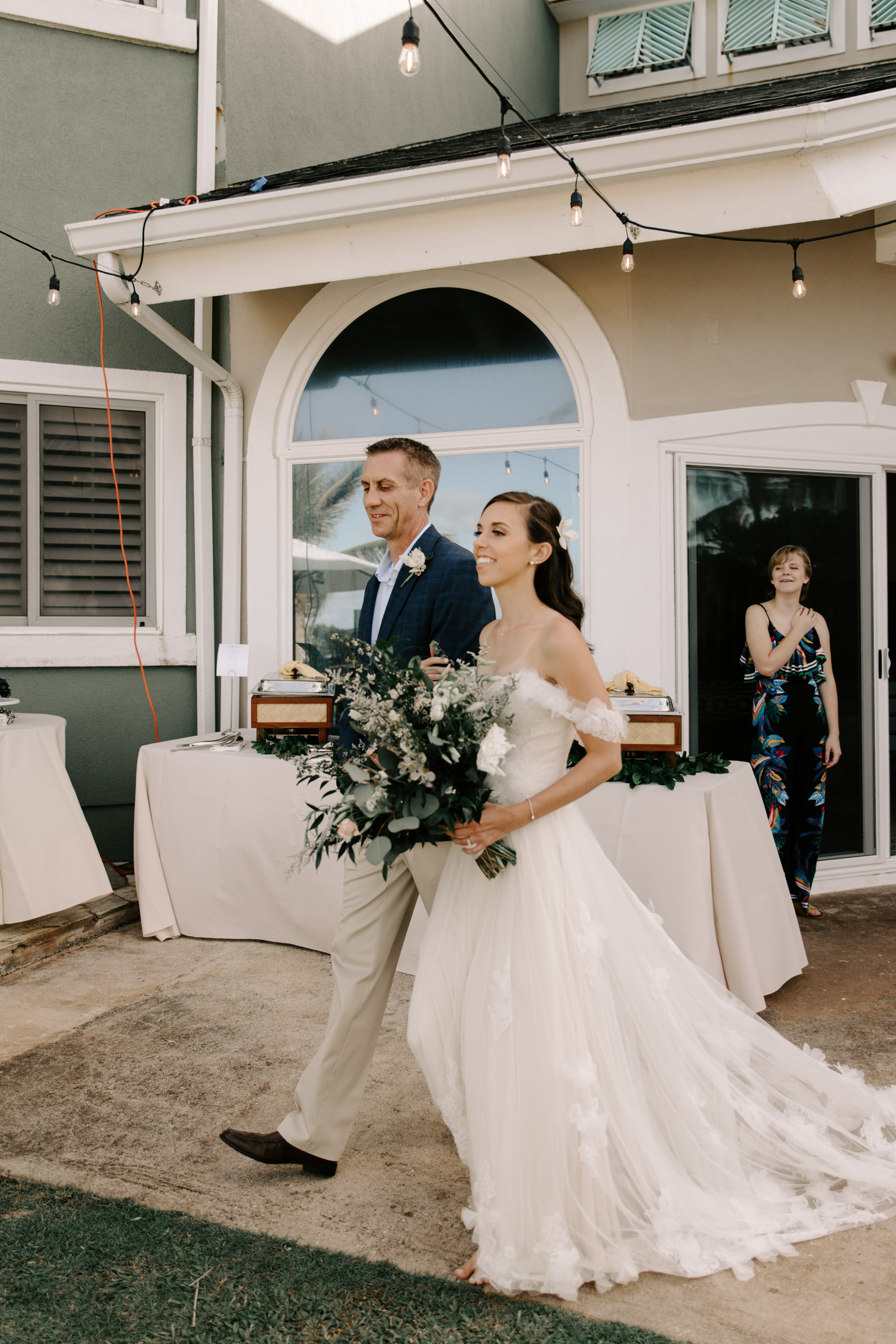 Father walking his daughter down the aisle- Laie Point Backyard Wedding By Hawaii Wedding Photographer Desiree Leilani