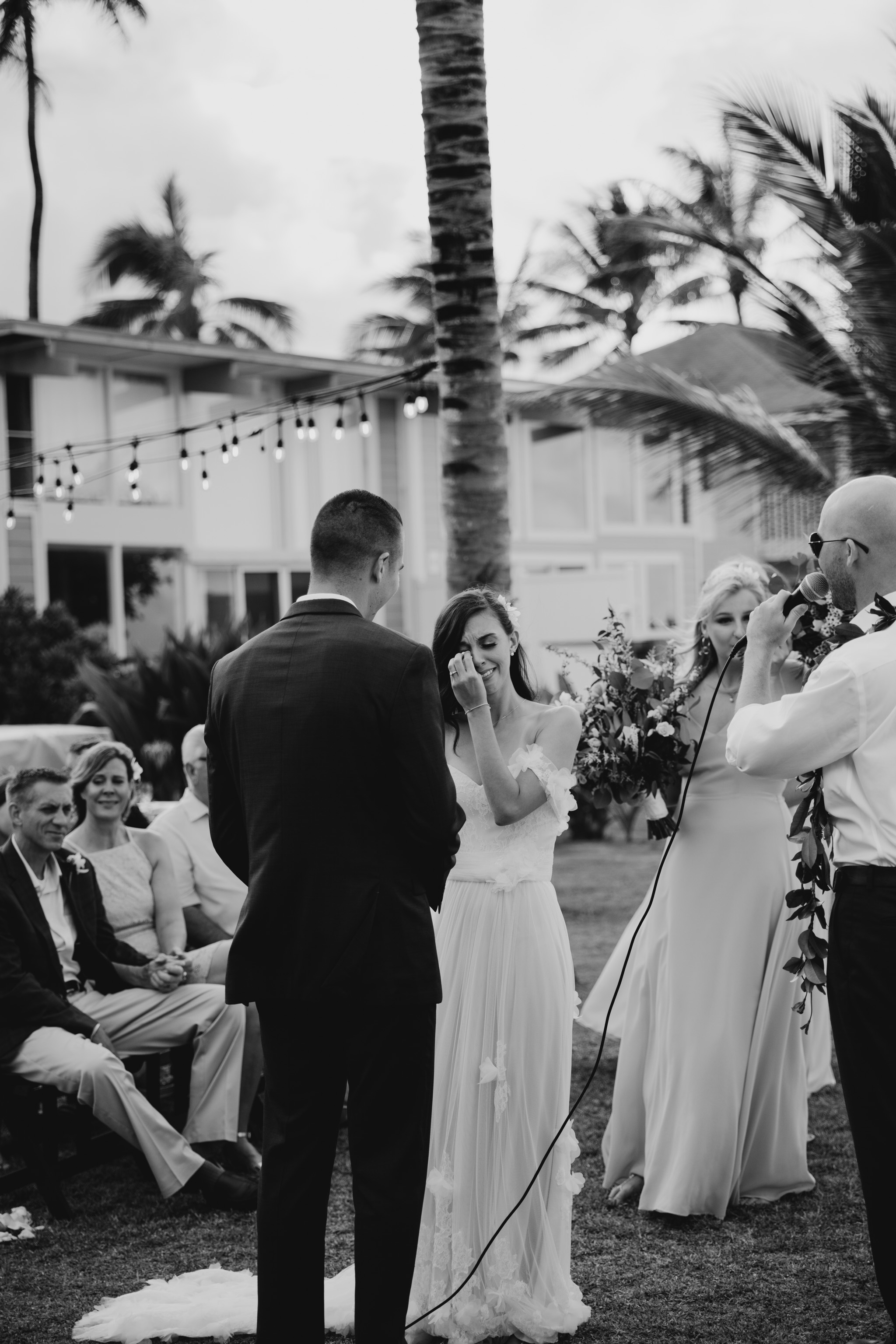 Bride crying during the ceremony- Laie Point Backyard Wedding By Hawaii Wedding Photographer Desiree Leilani