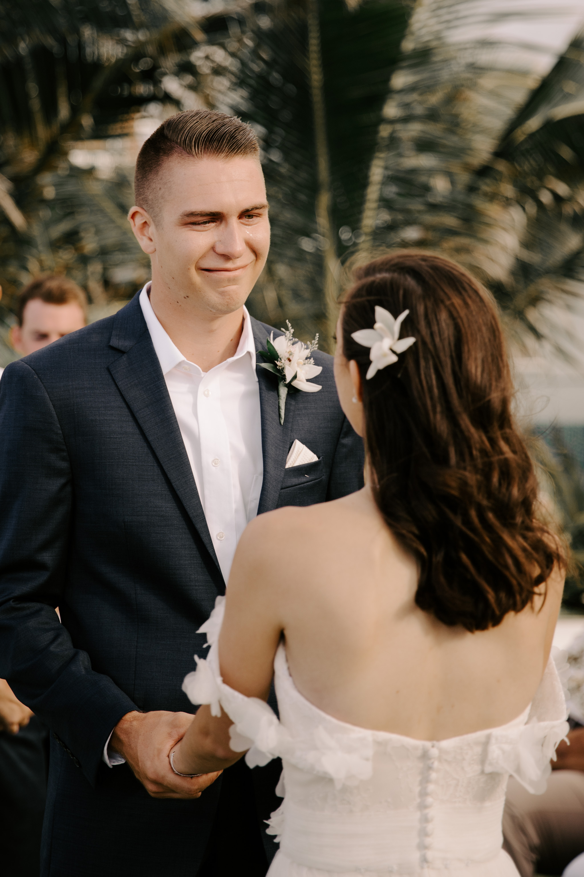 Groom crying during the ceremony- Laie Point Backyard Wedding By Hawaii Wedding Photographer Desiree Leilani
