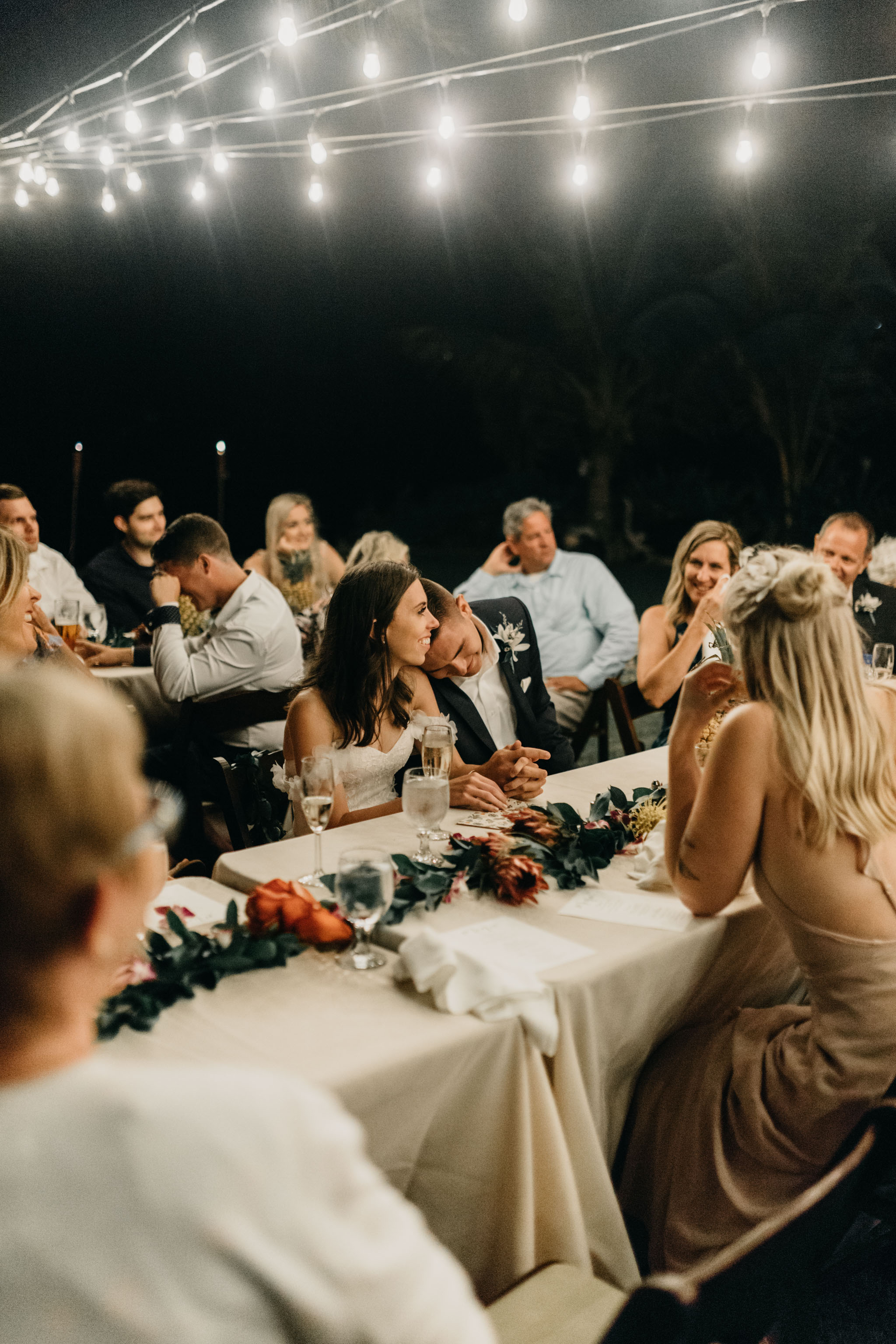 Bride and groom during the toasts- Laie Point Backyard Wedding By Hawaii Wedding Photographer Desiree Leilani