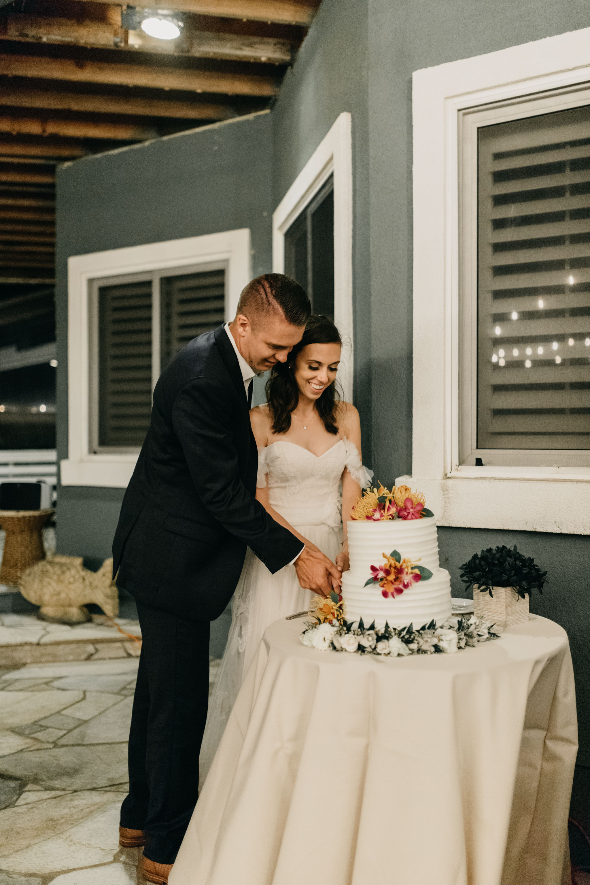 Cake cutting- Laie Point Backyard Wedding By Hawaii Wedding Photographer Desiree Leilani