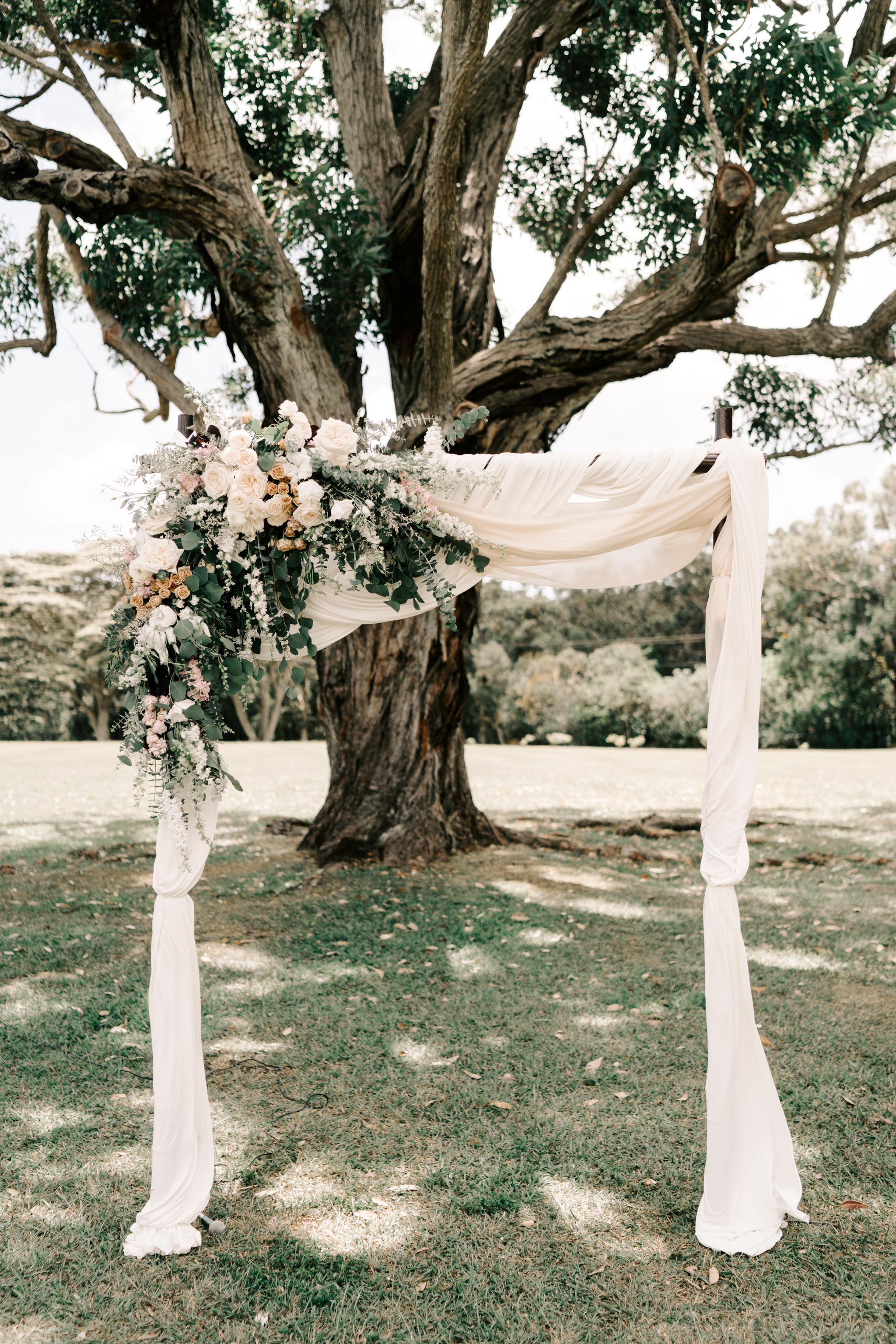 Floral Wedding Ceremony Arch Idea - Sunset Ranch Hawaii Wedding By Oahu Wedding Photographer Desiree Leilani