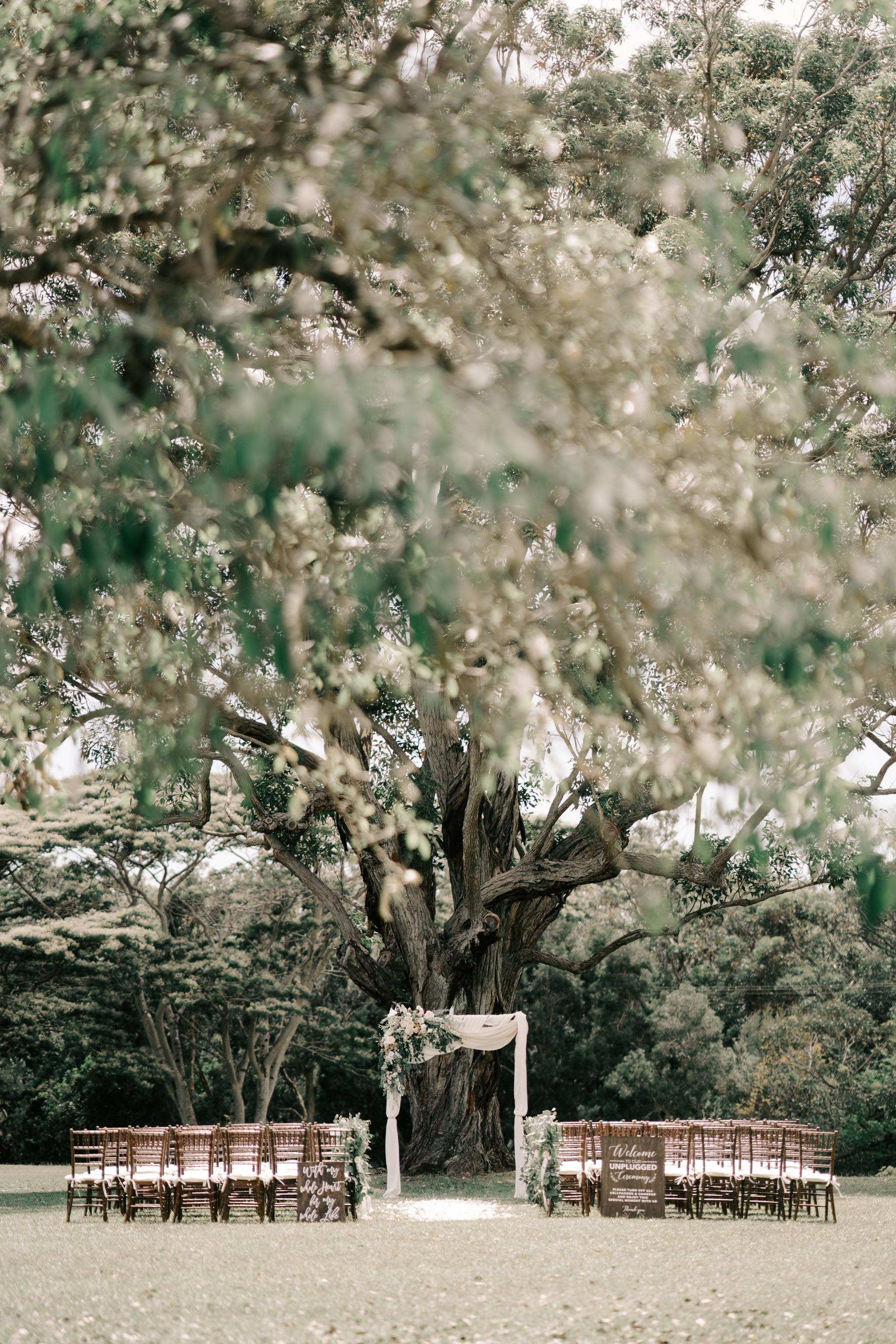 Gorgeous outdoor ceremony idea with floral arch - Sunset Ranch Hawaii Wedding By Oahu Wedding Photographer Desiree Leilani