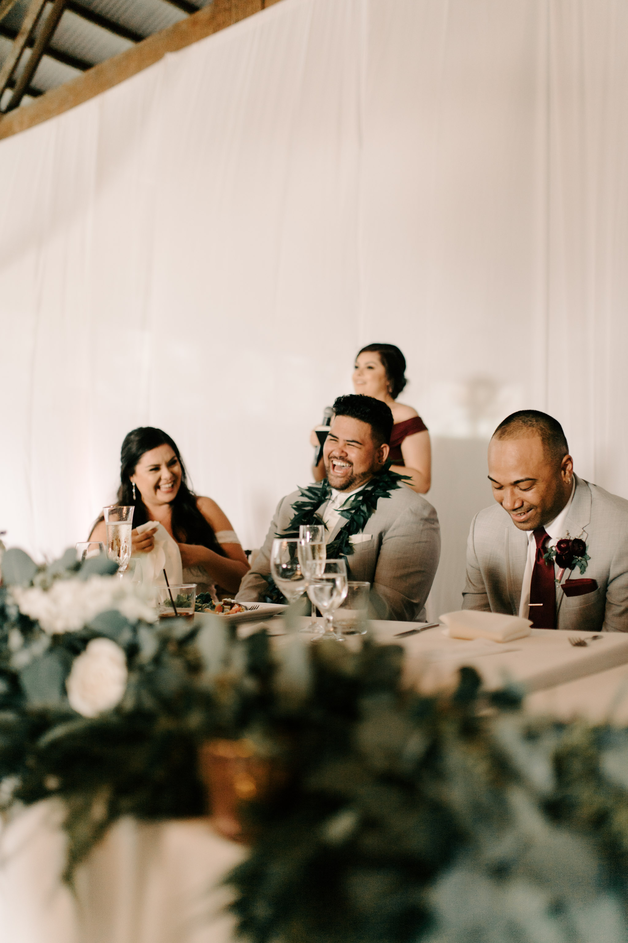 Bride and Groom's Reactions During the Toasts - Hawaii Barn Wedding Reception - Sunset Ranch Hawaii Wedding By Oahu Wedding Photographer Desiree Leilani