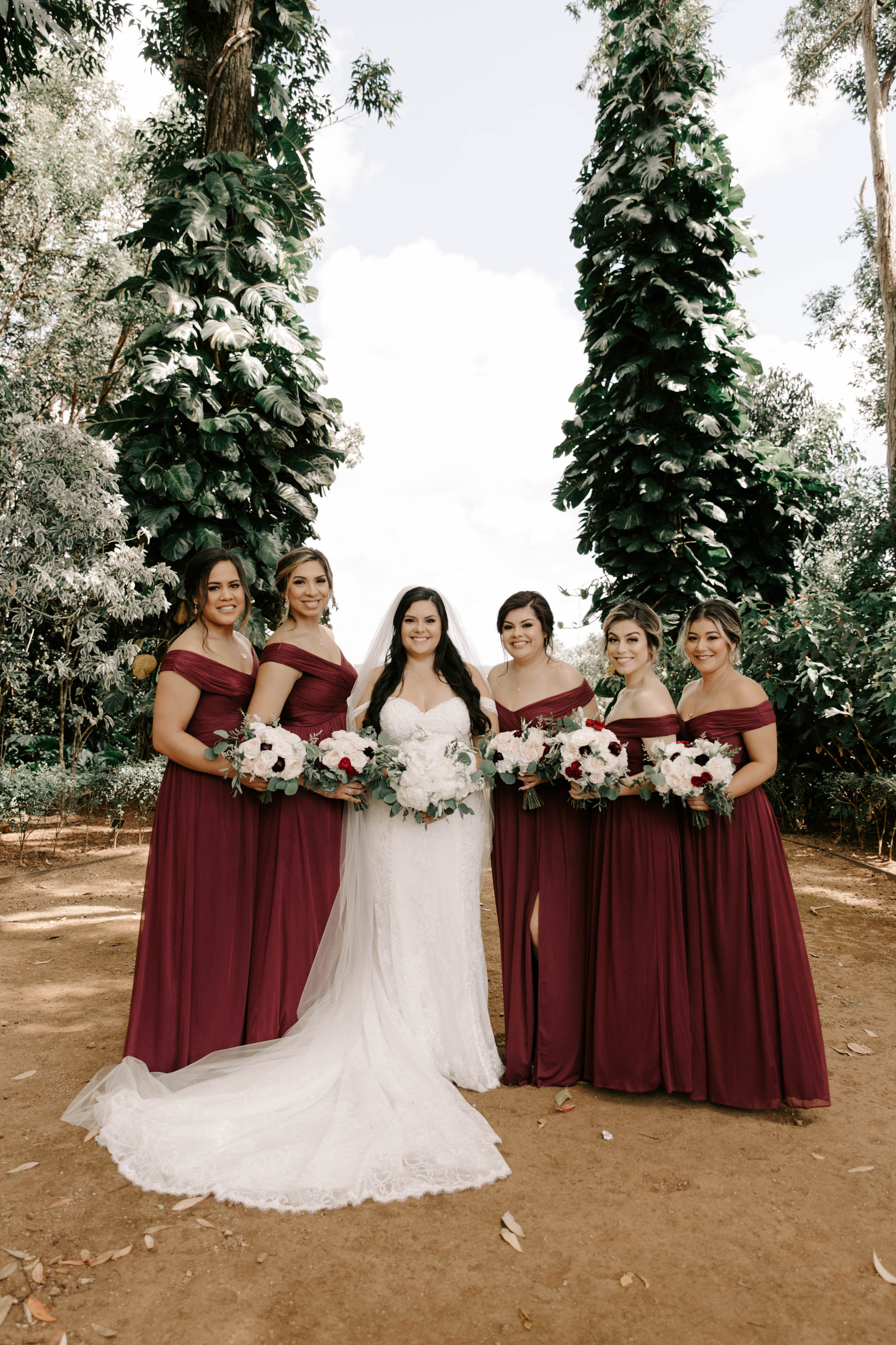 Bride and Bridesmaid Photo - Burgundy Bridesmaid Dresses - Sunset Ranch Hawaii Wedding By Oahu Wedding Photographer Desiree Leilani