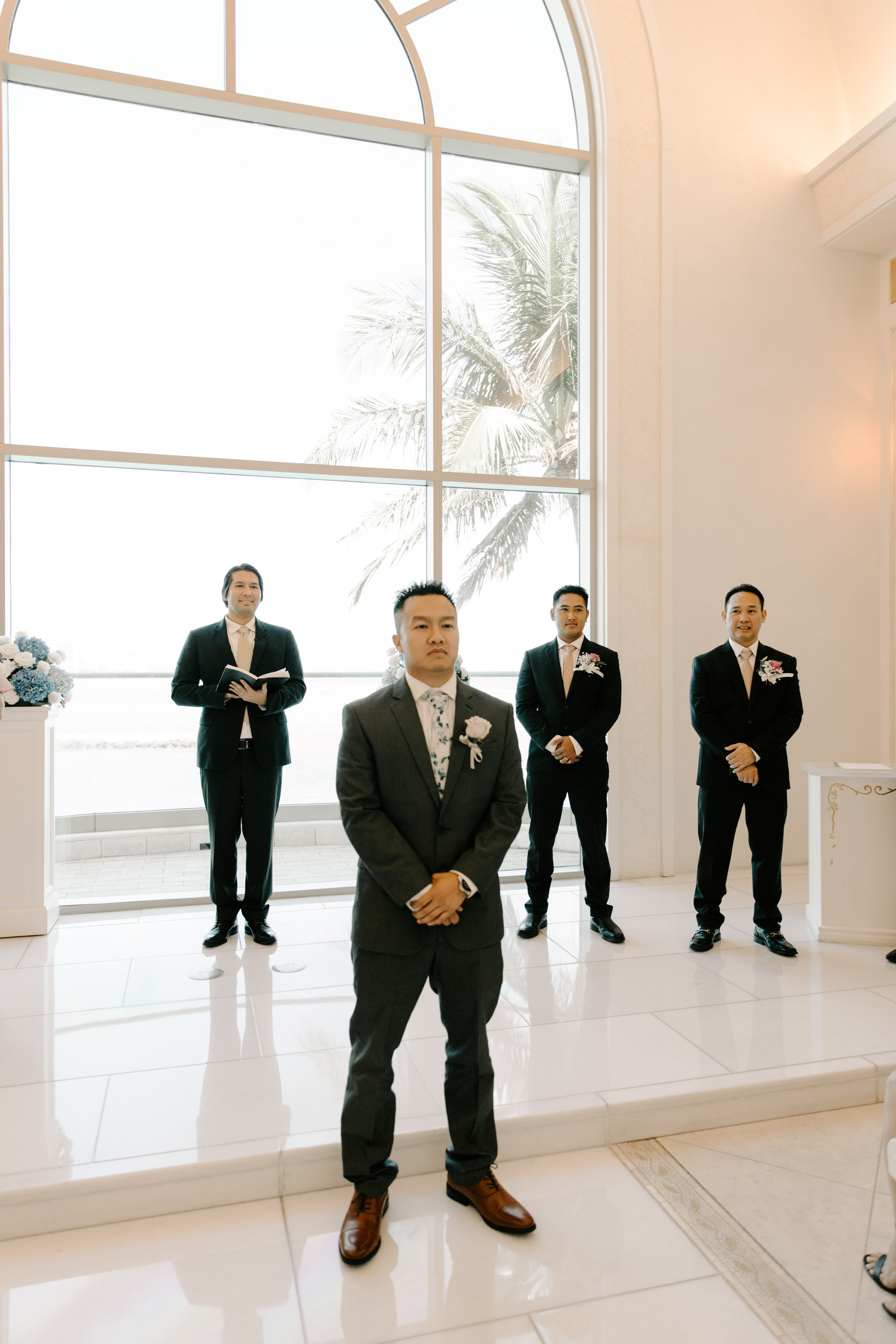 Groom waiting for his bride to walk down the aisle - 53 By The Sea Hawaii Wedding Naupaka Chapel By Oahu Wedding Photographer Desiree Leilani