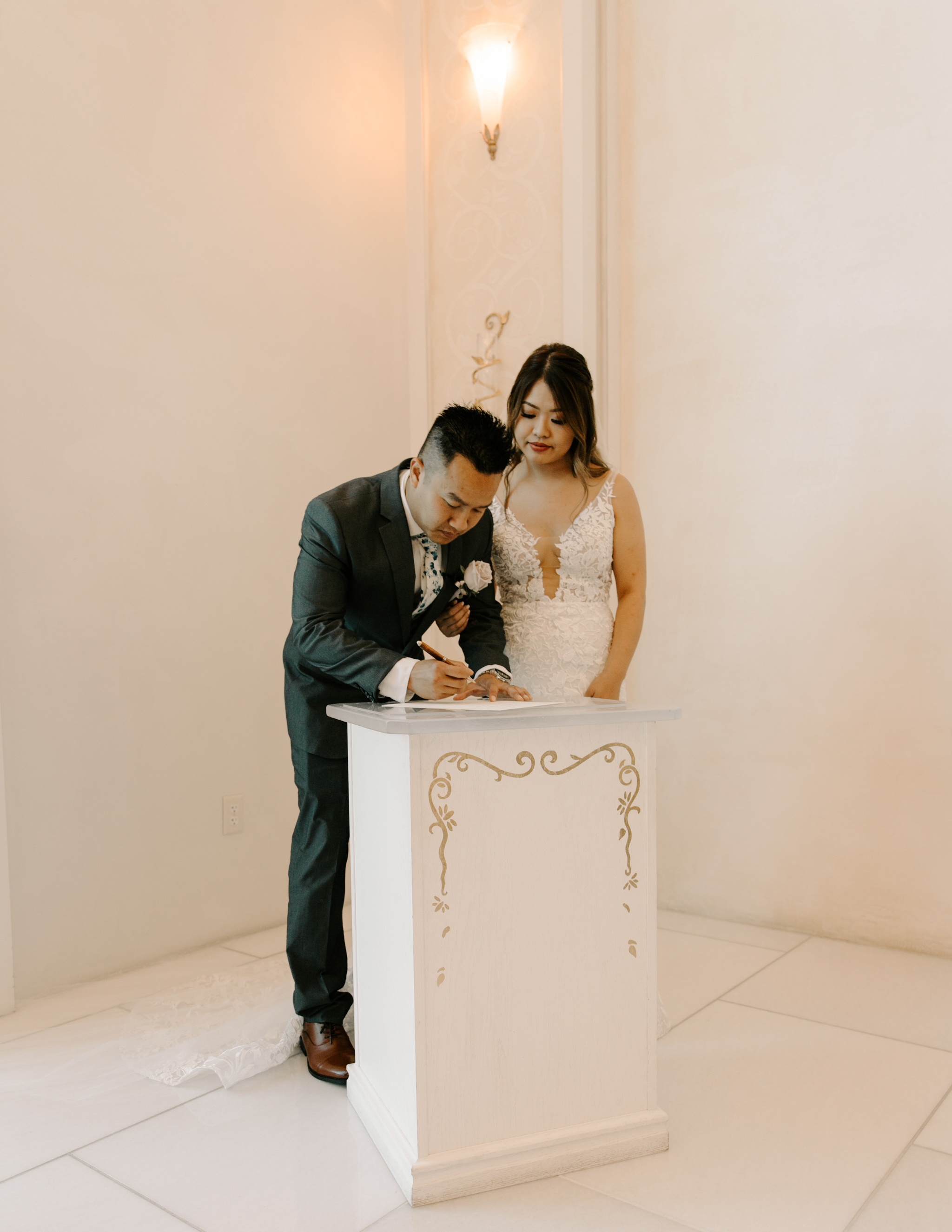 Signing the marriage certificate photo - 53 By The Sea Hawaii Wedding Naupaka Chapel By Oahu Wedding Photographer Desiree Leilani