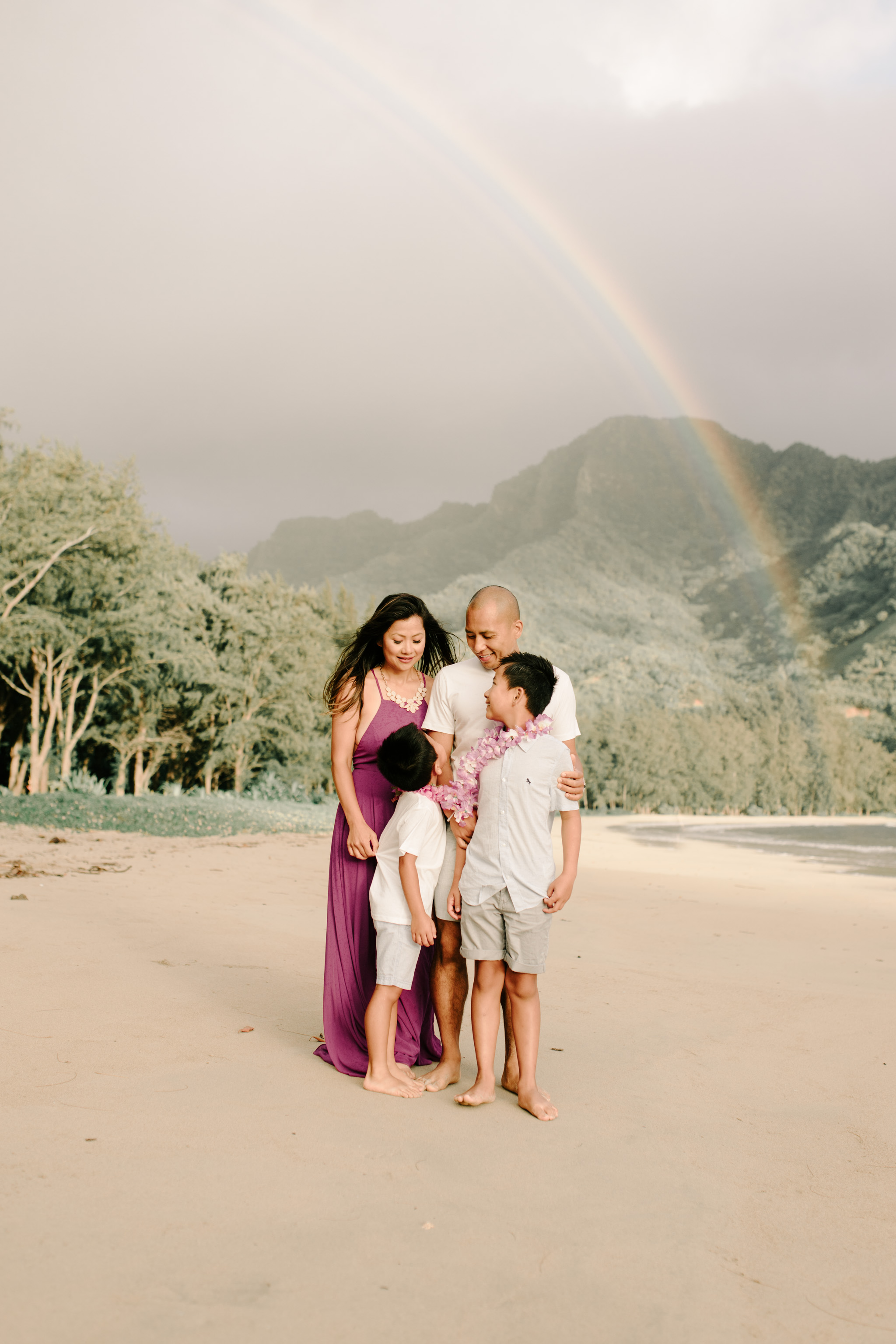 Beautiful Hawaii Family Photos on the Beach with a Gorgeous Rainbow in the Background - Photo by Oahu Family Photographer Desiree Leilani