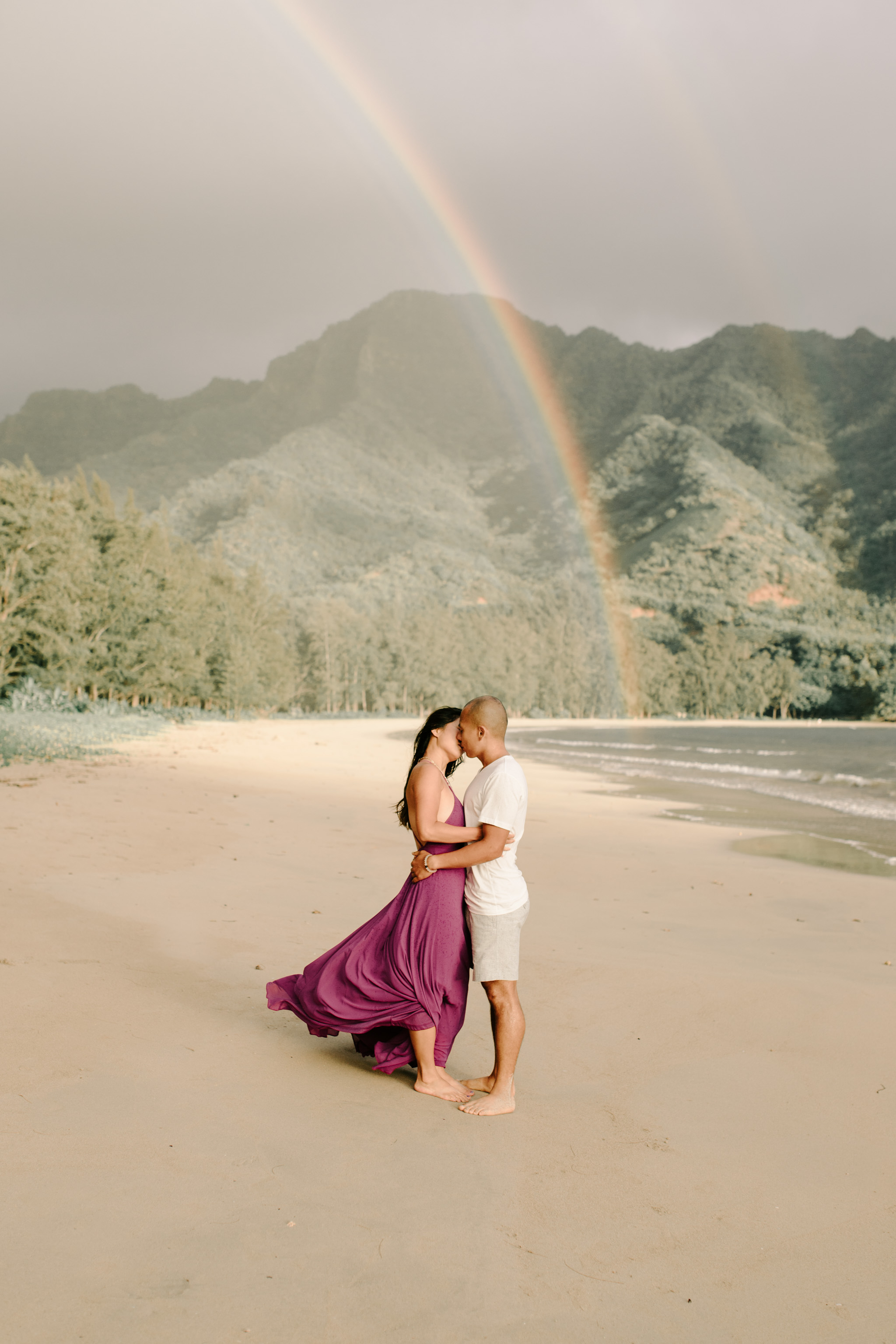 Beautiful Hawaii Couple Photos on the Beach with a Gorgeous Rainbow in the Background - Photo by Oahu Couple Photographer Desiree Leilani