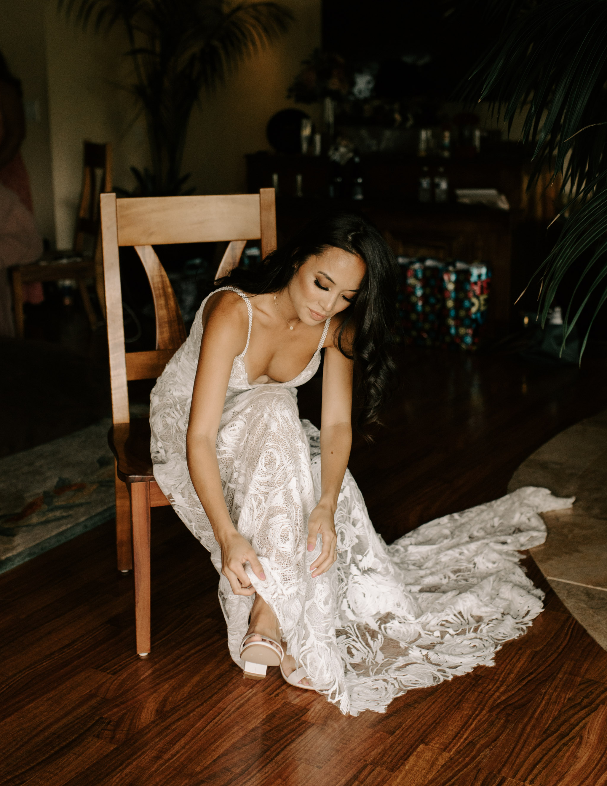 Bride Putting on Her Shoes in Her Grace Loves Lace Rosa Wedding Gown - Hale Koa Phineas Estate Wedding By Oahu Wedding Photographer Desiree Leilani