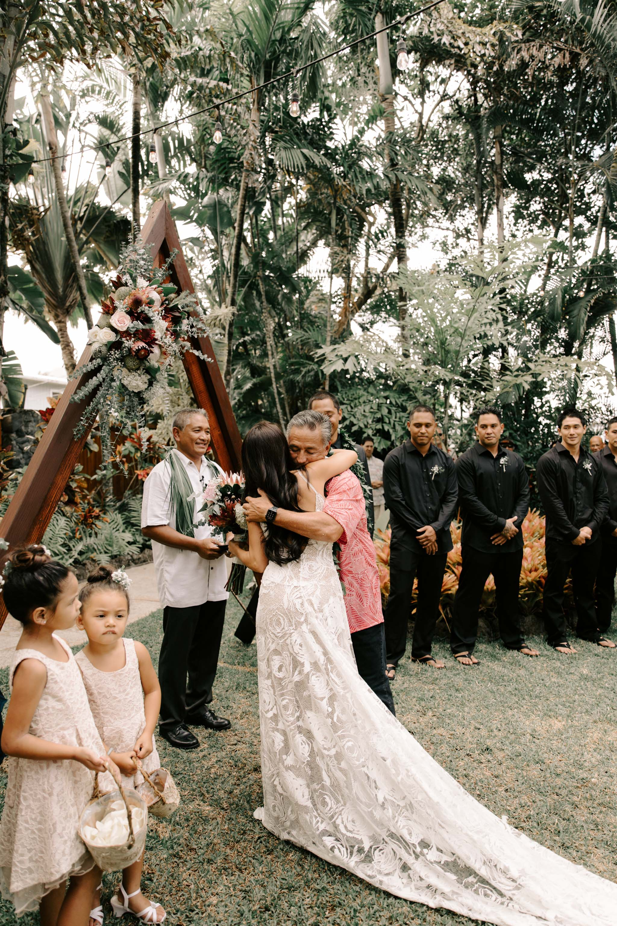 Father giving his daughter away at her wedding - Hale Koa Phineas Estate Wedding By Oahu Wedding Photographer Desiree Leilani
