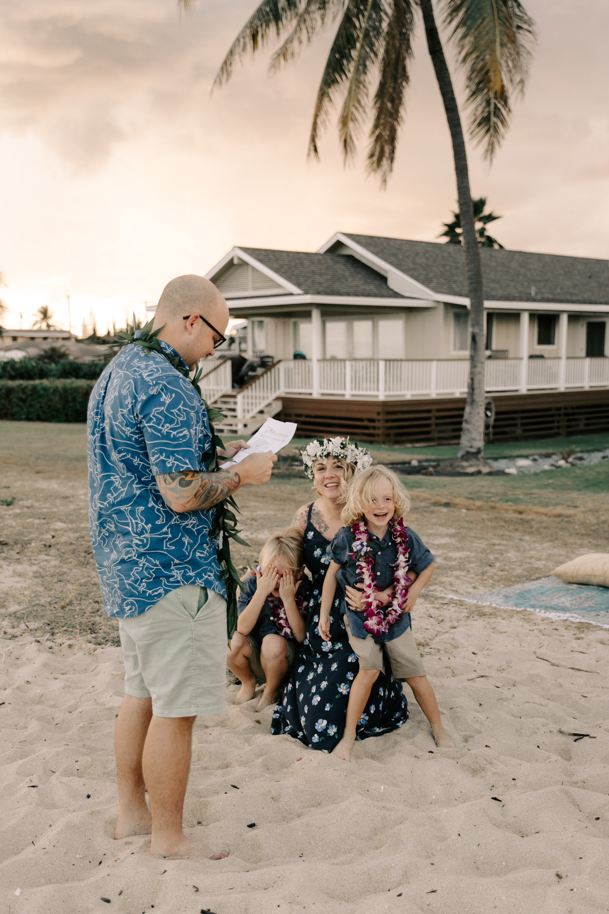 Reading vows to their children- Aloha Picnics Puuloa Beach Park Hawaii Vow Renewal By Oahu Wedding Photographer Desiree Leilani