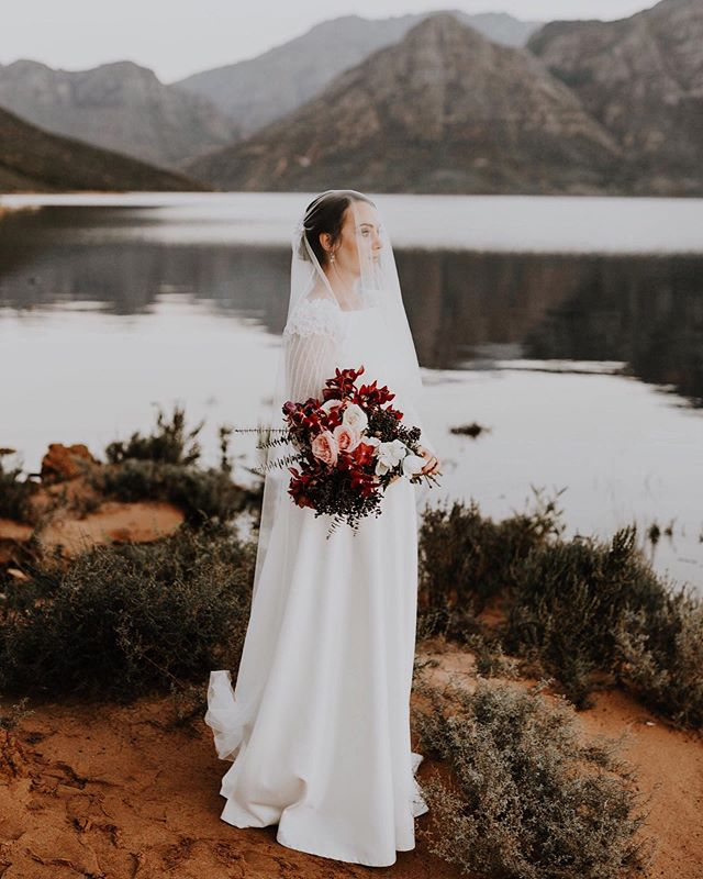Beautiful Eeden & the Franschoek mountains ♡ ♡ ♡ ⠀ .⠀ .⠀ @eedeneekers @nickeekers @alanavanheerdenbridal @blomstories @theconservatoryinfranschhoek @amocreative @baie_goeters @annah_styling @esfilms @tableclothhiring @nadiamakeupandhair @kusjkaduplessis @birdcage_stellenbosch ⠀⠀ .⠀⠀ .⠀⠀ .⠀⠀ #capetownweddingphotographer #capetown #southafrica #shesaidyes #bride #bohowedding #junebugweddings #wedding #belovedstories #photobugcommunity #couplegoals #loveandwildhearts #dirtybootsandmessyhair #weddinginspo #justmarried #saweddingphotographer #heyheyhellomay #capetownphotographer #weddinginspiration #moments #documentlife #weddingideas #elopementphotographer #verlief #rawandreal #capetownwedding #destinationweddingphotographer #documentwedding #verloof