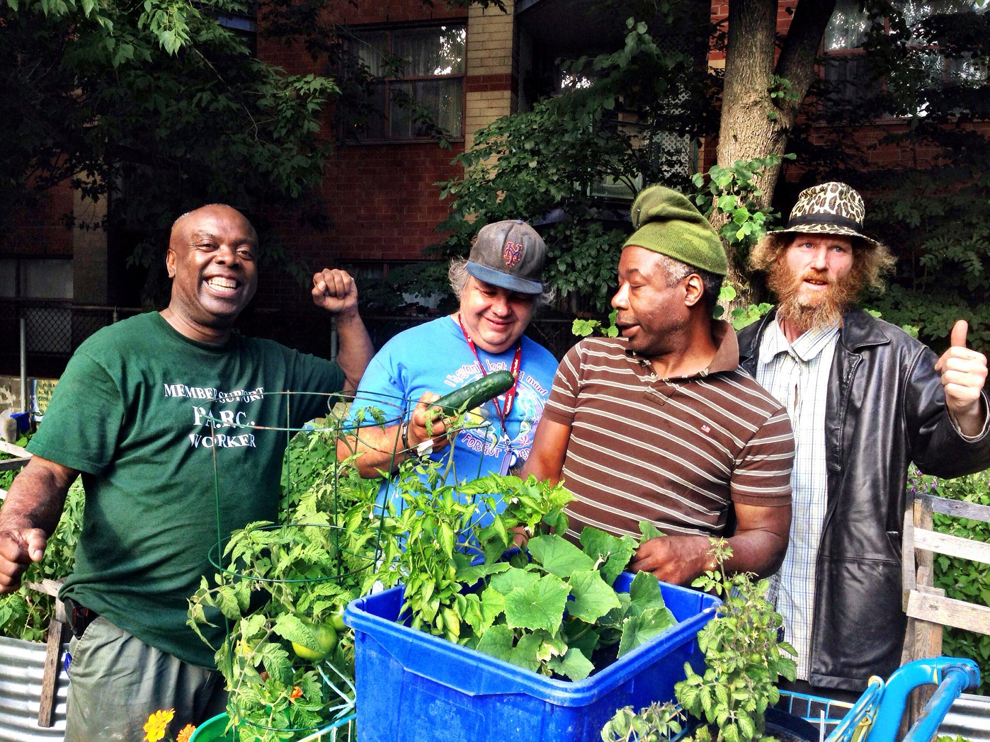 Eugene, Robbie, Glenmore, and James celebrate the harvest.