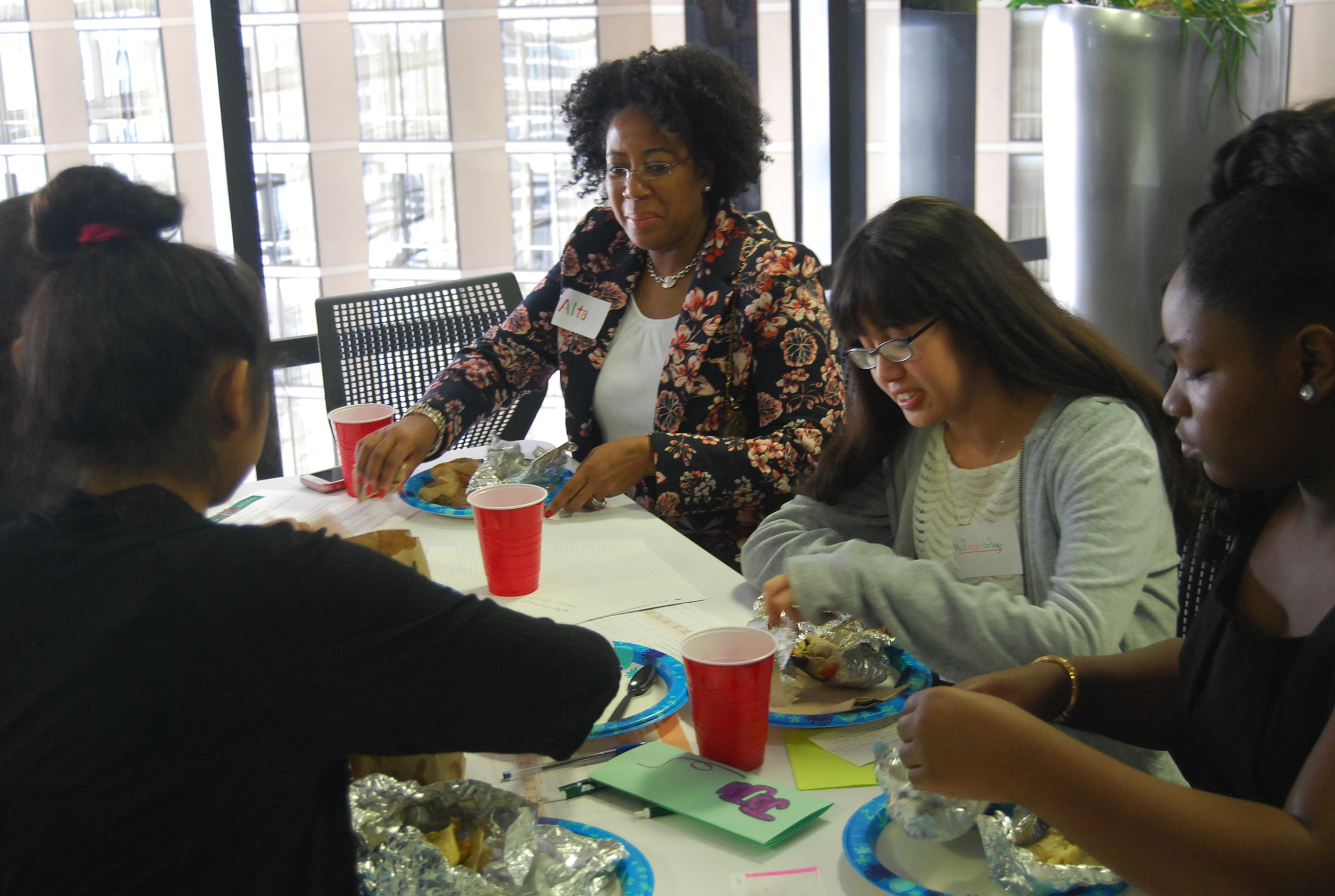 After working hard all morning, a pitch team enjoys lunch with pitch judge and  Altatudes  founder Alta Y. Alexander.