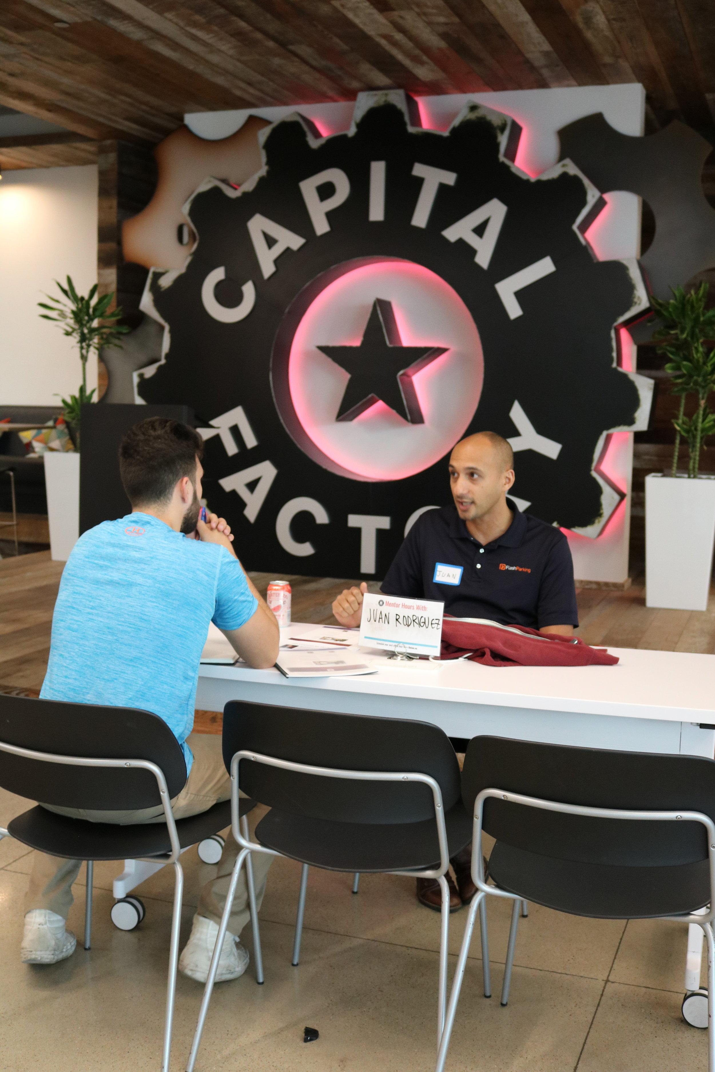 Juan Rodriguez mentors a teen entrepreneur during EPIC office Hours