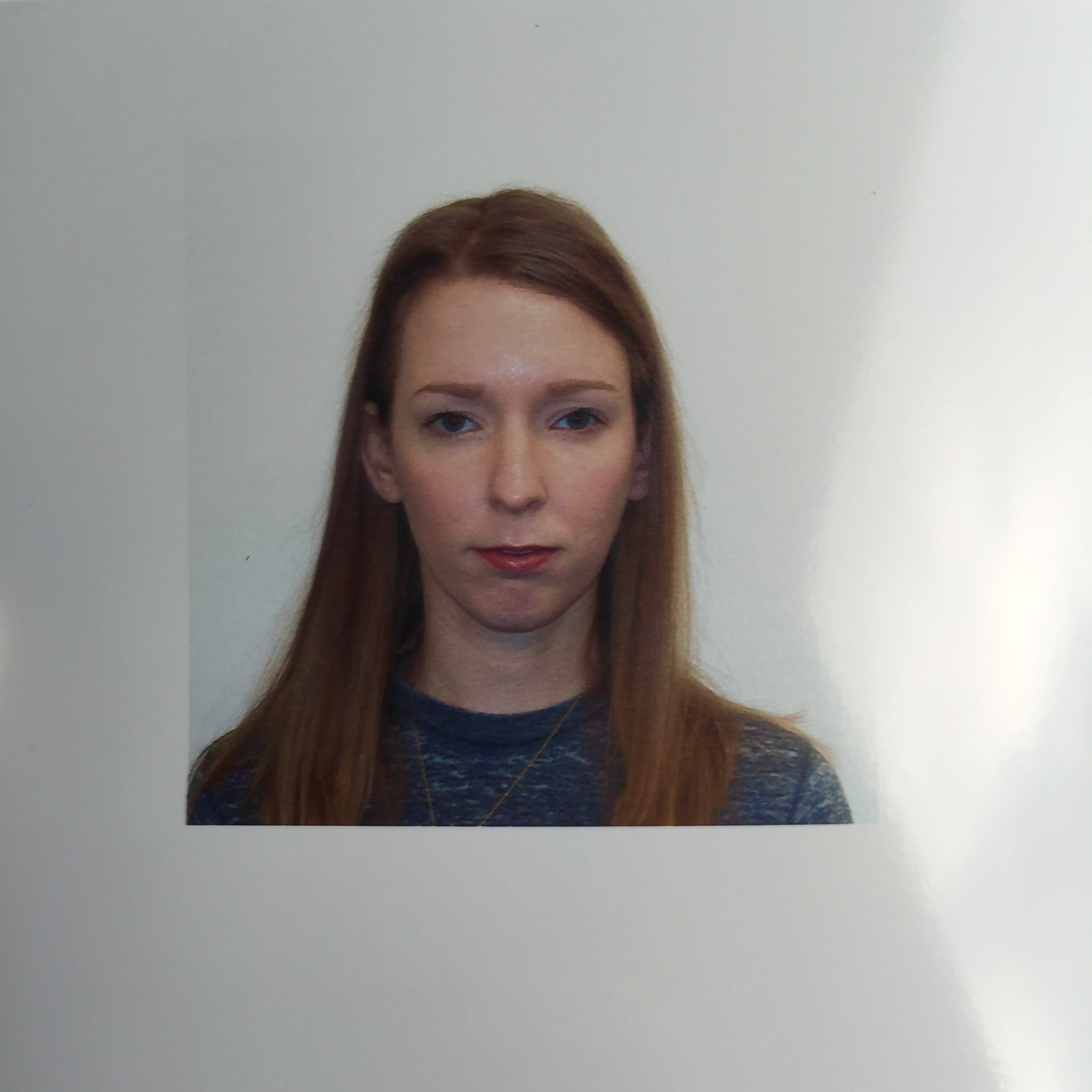 I finally got my passport application turned in, and this is the unfortunate photo that will follow me around the world for ten years