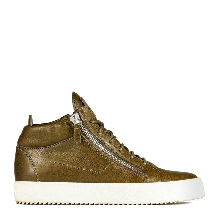 TAZ: A mid-top sneaker in olive green leather with lateral zips and a white contrasting sole.