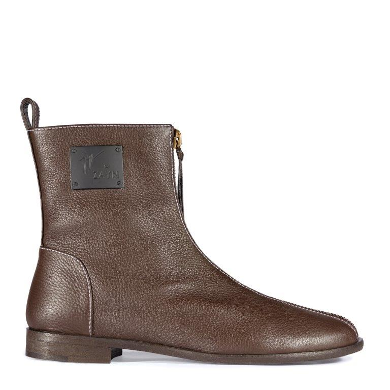 YASR: Featured in brown and black leather with contrast top stitching, an innovative, minimalist boot designed with a front zip that extends from the ankle down to the toe.