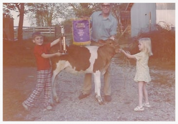 My brother, my Dad and I with our award winning show calf